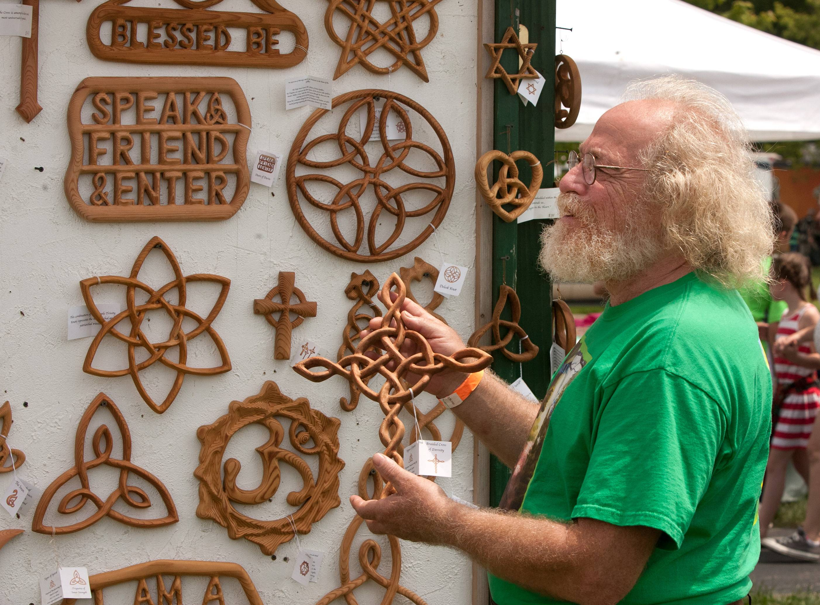 Mark Cooper of Magnolia, Texas, sells hand-carved woodwork during the Scottish Festival and Highland Games at Hamilton Lakes in Itasca.
