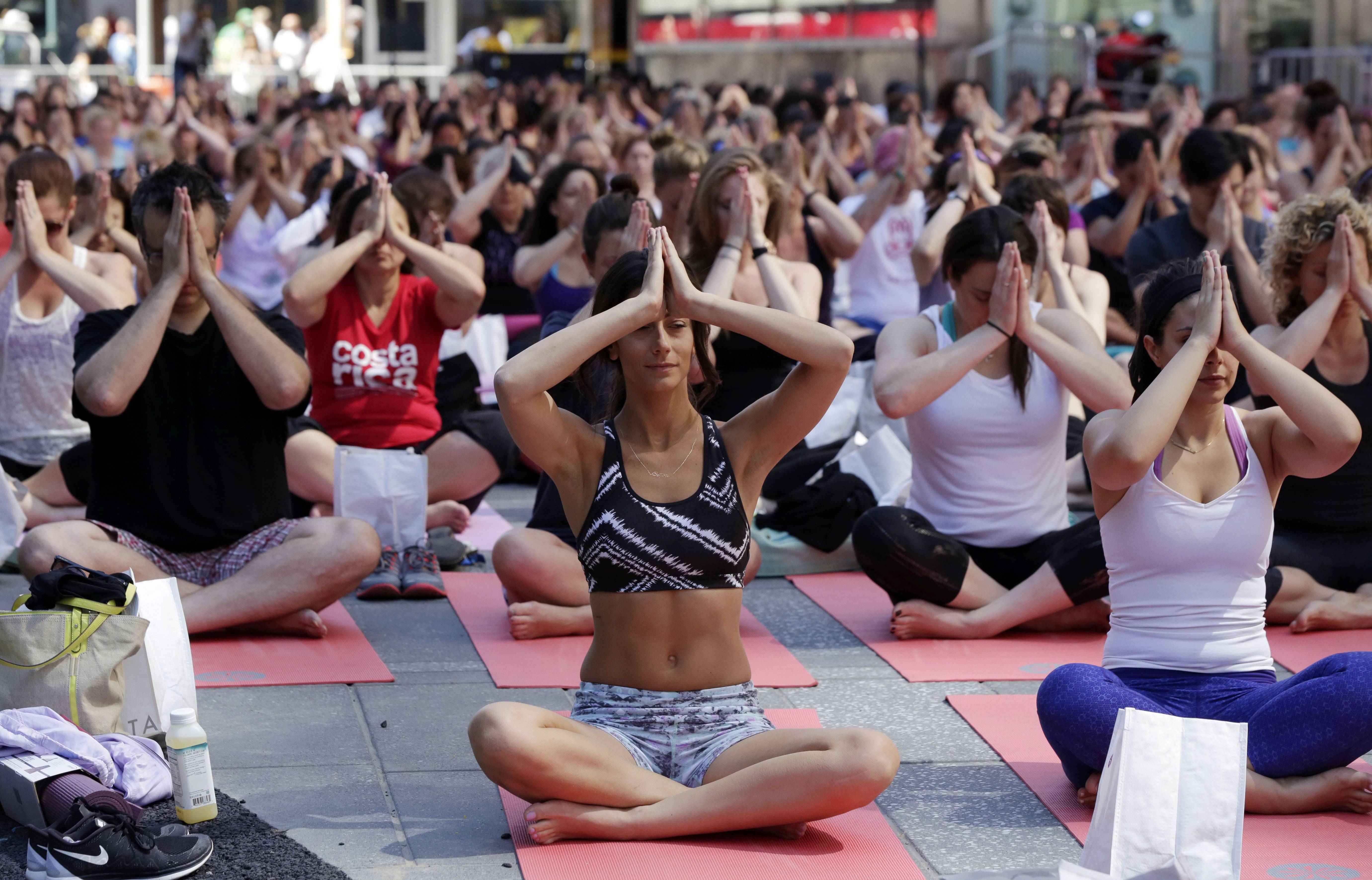 Thousands of New Yorkers marked the first day of summer by practicing yoga in Times Square.