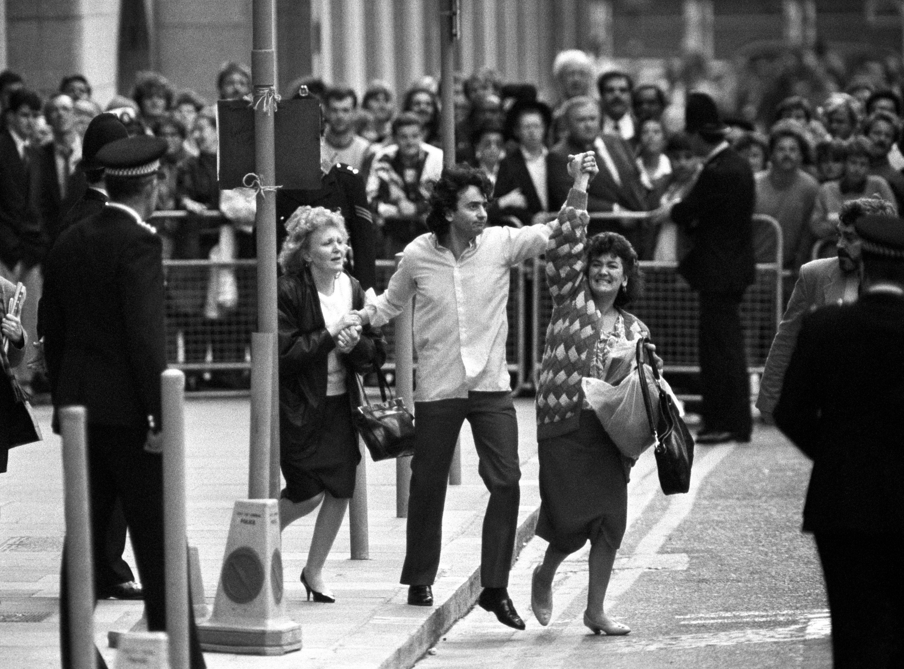 "In this Oct. 19, 1989 file photo, Gerry Conlon, center, is seen outside the Old Bailey after being released for being wrongly convicted of the Guilford pub bombings, in London. His family says Gerry Conlon, who was imprisoned unjustly for an IRA bombing and inspired an Oscar-nominated film, has died at his Belfast home after a long battle with cancer. The 60-year-old Conlon was a central figure in one of Britain's greatest miscarriages of justice. He and three others were convicted and sentenced to life for the 1974 bombing of a pub in Guildford, near London, that killed five people. Conlon always protested his innocence, a position vindicated in 1989 when the so-called Guildford Four were exonerated and freed. By then his father Giuseppe, convicted of an alleged lesser role in the bombing, had already died behind bars. Conlon's autobiography, ""Proved Innocent"" was the basis for 1993's ''In the Name of the Father'' starring Daniel Day-Lewis as Conlon."