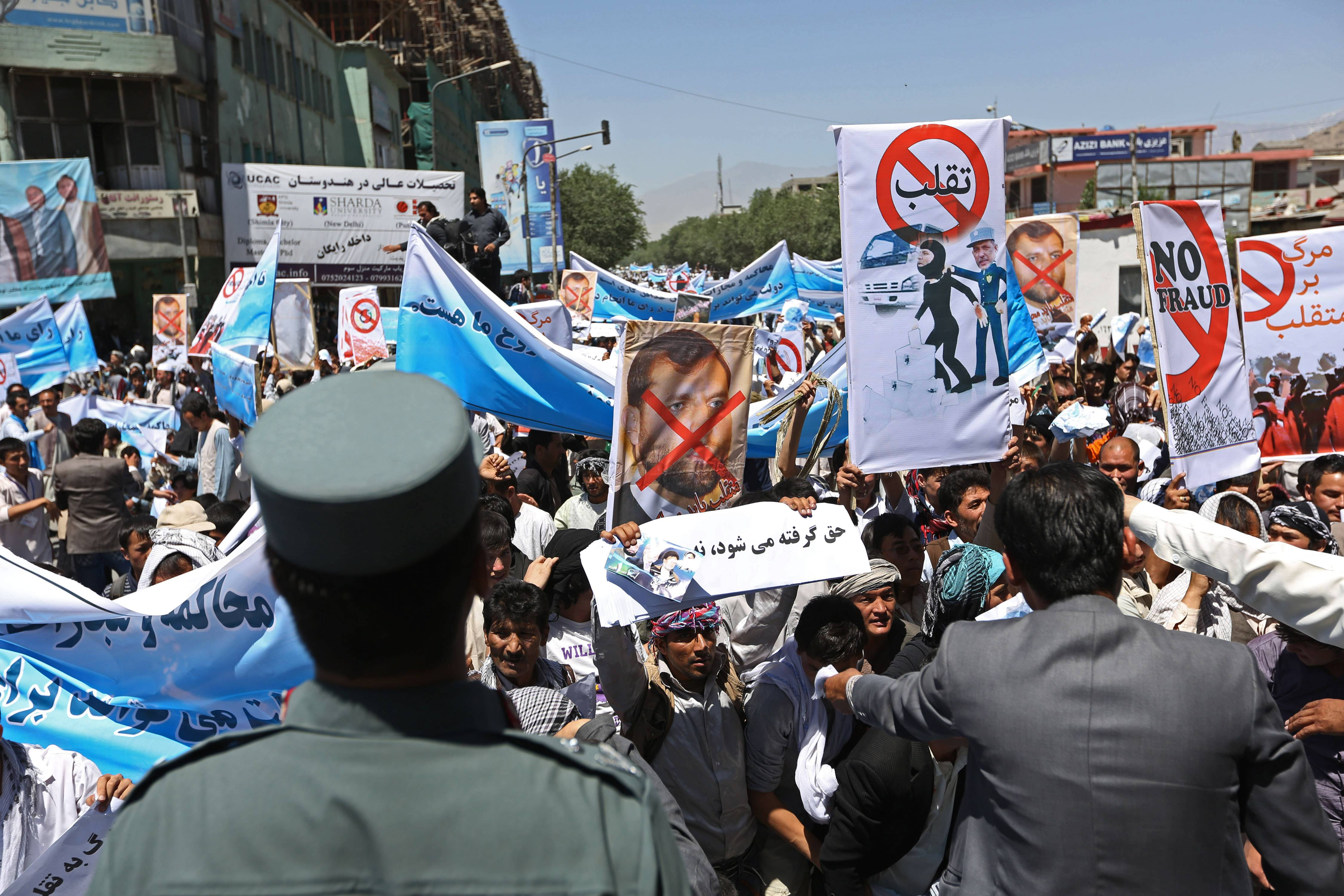 Supporters of presidential candidate Abdullah Abdullah shouts slogans during a protest in Kabul, Afghanistan, Saturday, June 21. Former Foreign Minister Abdullah, who is running against Ashraf Ghani Ahmadzai, a former finance minister, has accused electoral officials and others of trying to rig the June 14 vote against him.