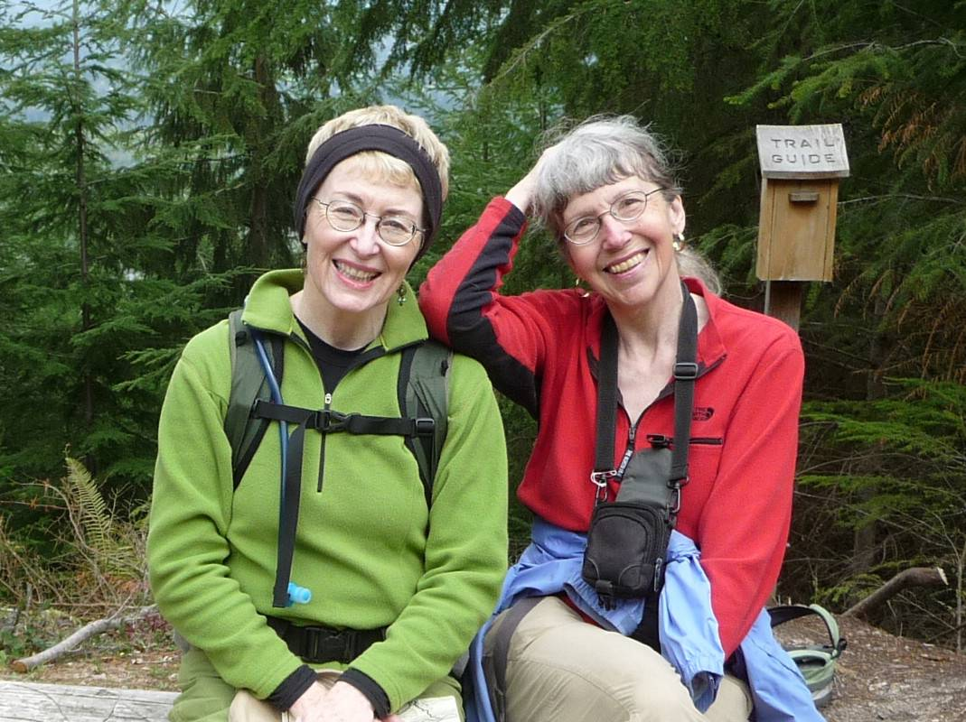 This undated image provided by Lola Kemp shows missing hiker Karen Sykes, right, with her friend Kemp. Crews searched Mount Rainier National Park on Friday for Sykes, a prominent hiker and outdoors writer who was reported missing late Wednesday. The search continued early Saturday, June 21. She was working on a story at the time, park spokeswoman Patti Wold said.