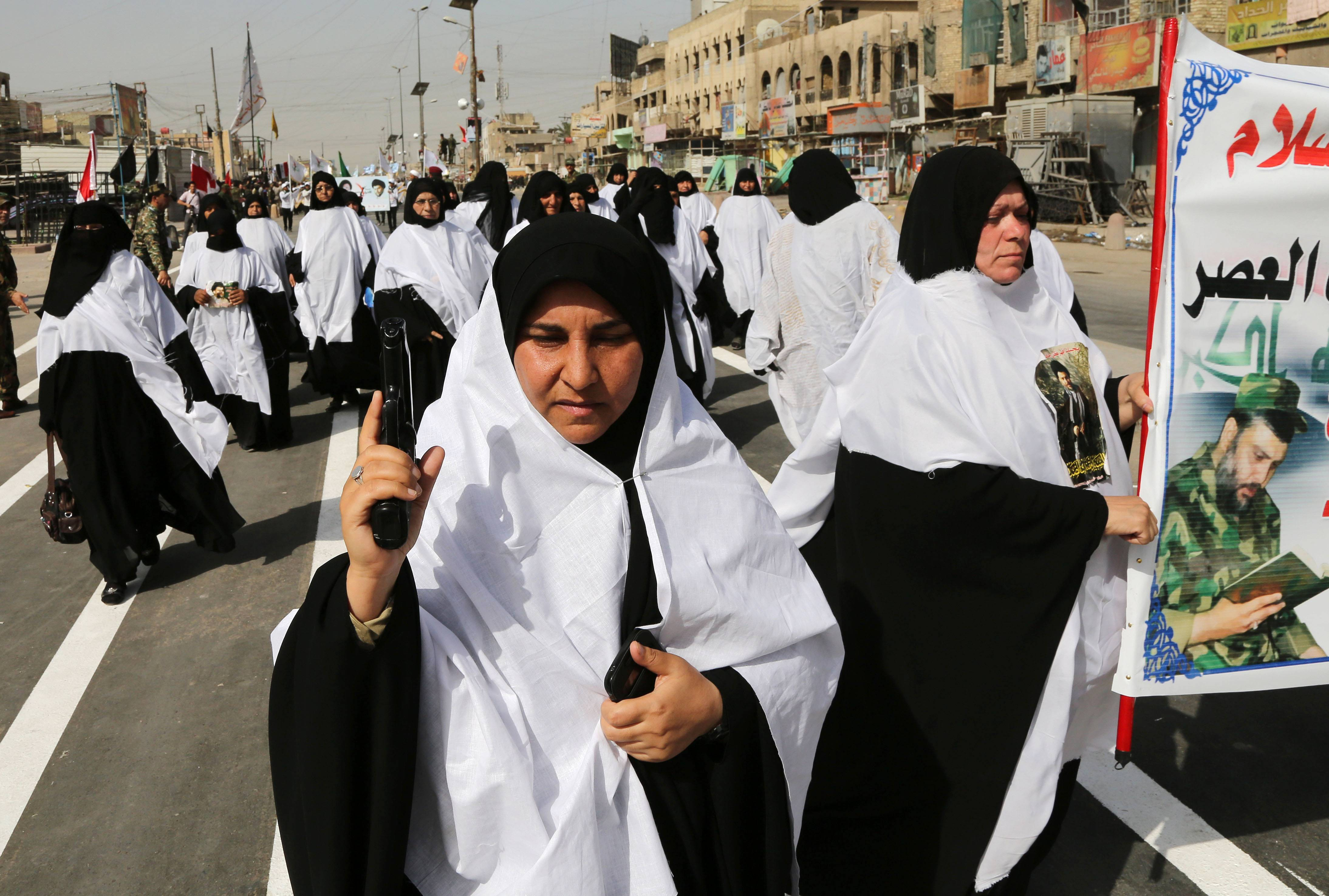"Volunteers of the newly formed ""Peace Brigades"" participate in a parade in the Shiite stronghold of Sadr City, Baghdad, Iraq, Saturday, June 21. Thousands of Shiite militiamen have paraded in Baghdad and several other cities in southern Iraq with heavy weaponry, signaling their readiness to take on Sunni militants who control a large chunk of the country's north."