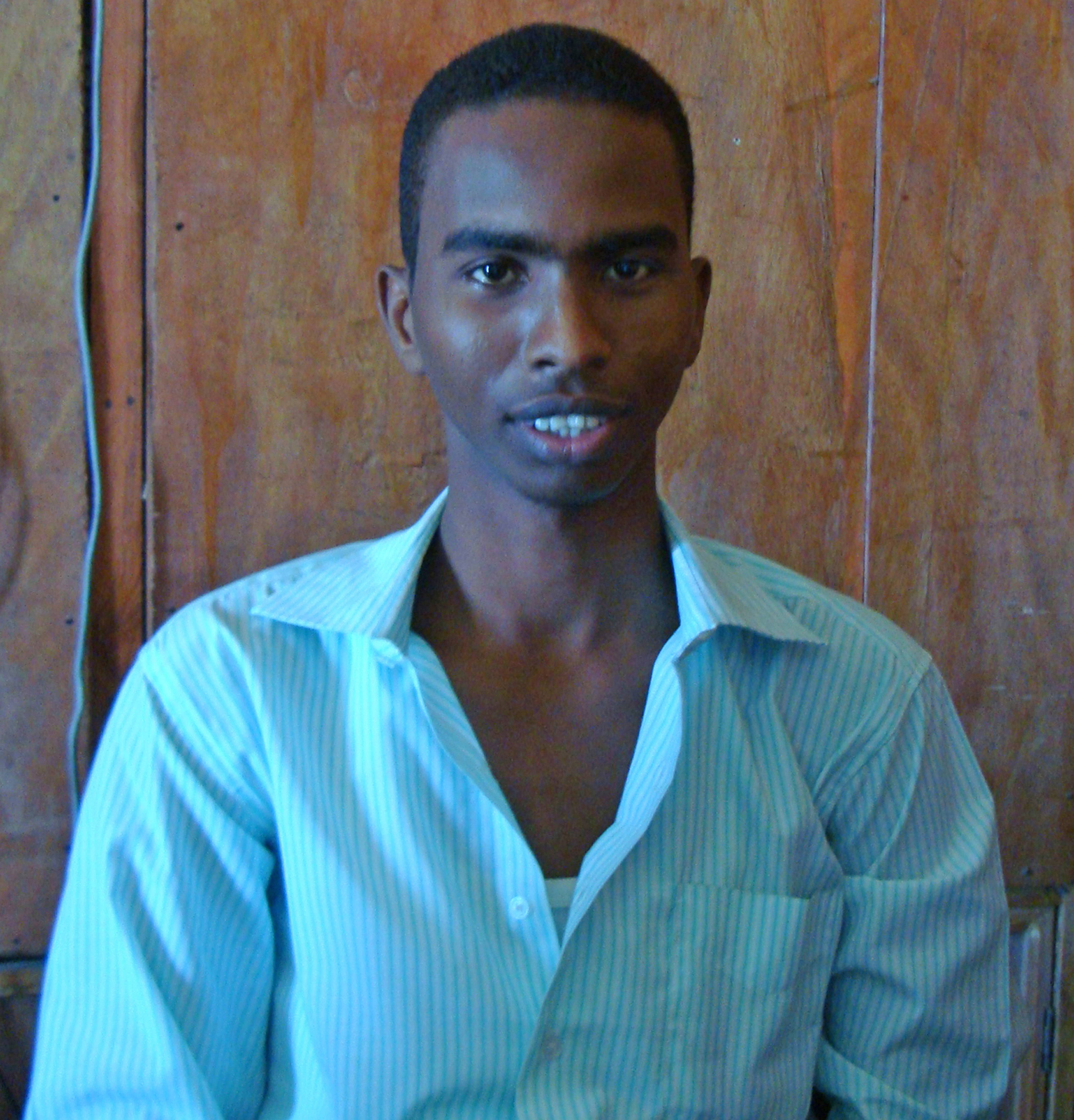 In this photo taken in 2010, Somali journalist Yusuf Keynan sits in radio station center in Kenya. No group has claimed the responsibility the Assassination of Yusuf Keynan, the editor of Mustaqbal radio in Mogadishu, who was killed as a bomb planted under his car exploded as he attempted to travel to work in the morning, a colleague of the murdered reporter has said.
