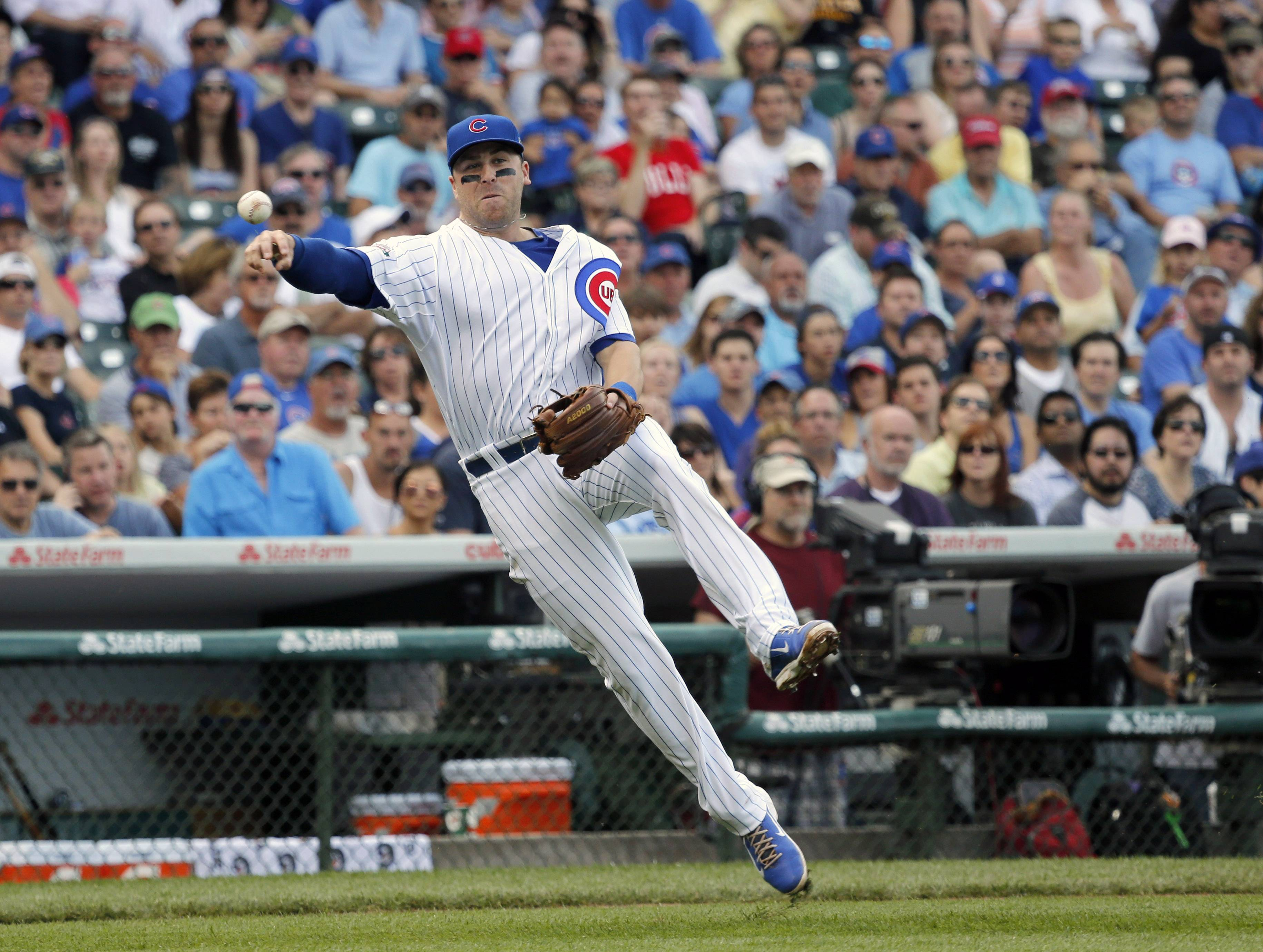 Chicago Cubs third baseman Mike Olt throws out Pittsburgh Pirates' Russell Martin after fielding Martin's sacrifice bunt during the second inning of a baseball game on Friday, June 20, 2014, in Chicago.