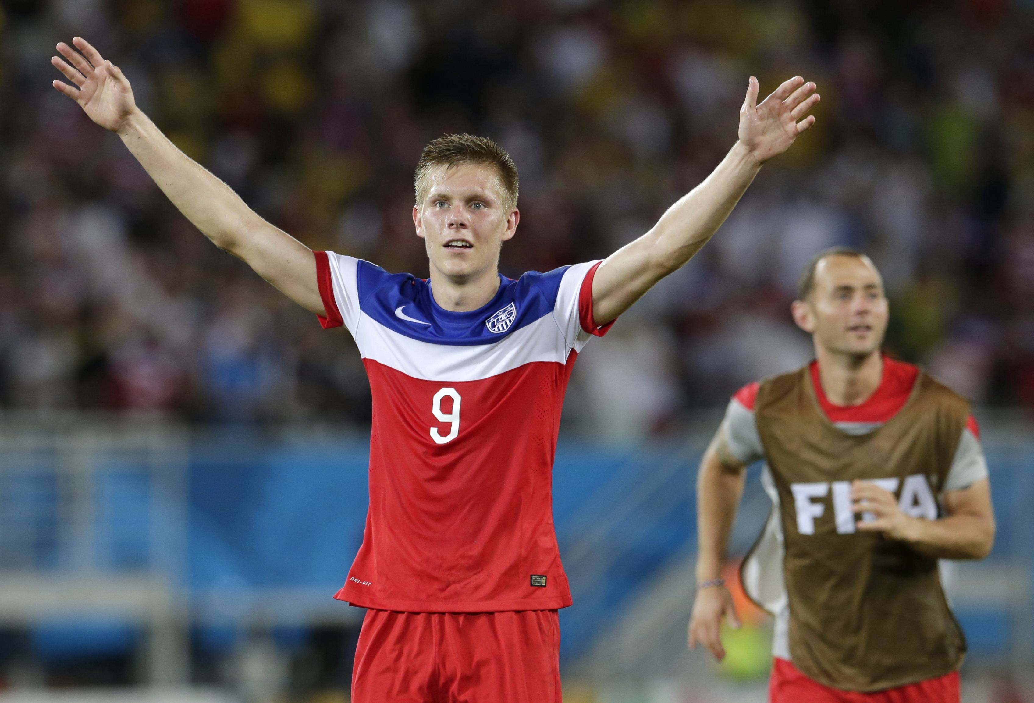 United States' Aron Johannsson celebrates his team's 2-1 victory over Ghana during the group G World Cup soccer match between Ghana and the United States at the Arena das Dunas in Natal, Brazil, Monday, June 16, 2014.