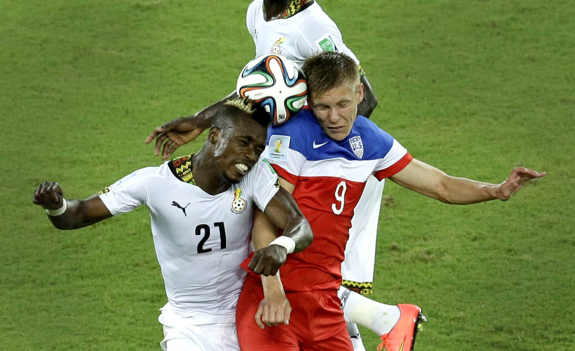 Ghana's John Boye, left, and United States' Aron Johannsson go for a header during the group G World Cup soccer match between Ghana and the United States at the Arena das Dunas in Natal, Brazil, Monday, June 16, 2014.