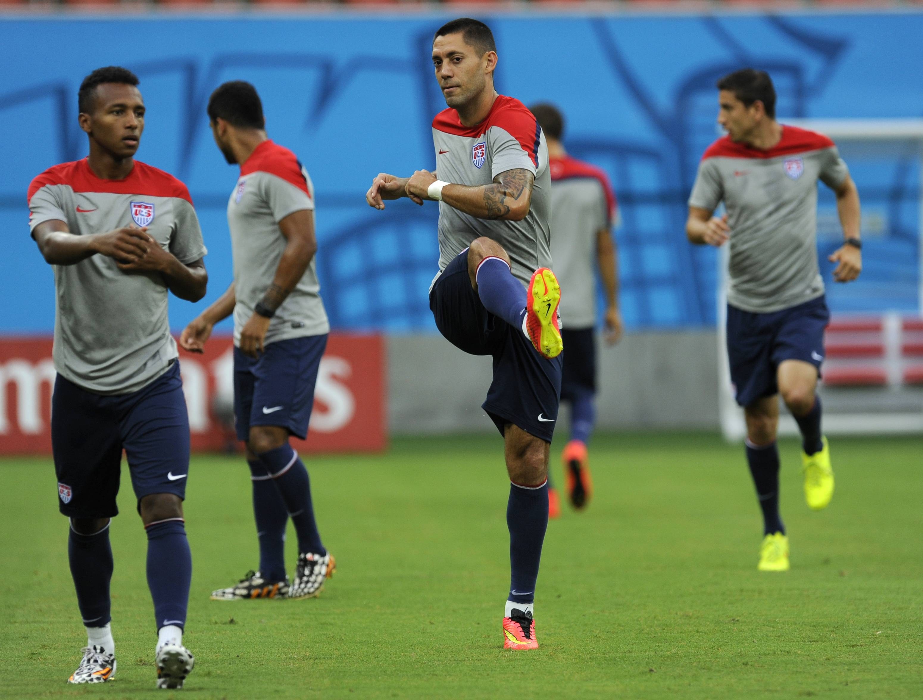The United States' Clint Dempsey, center, and Julian Green, left, work out during a training session Saturday at the Arena da Amazonia in Manaus, Brazil. The U.S. will play Portugal in group G of the 2014 soccer World Cup Sunday.