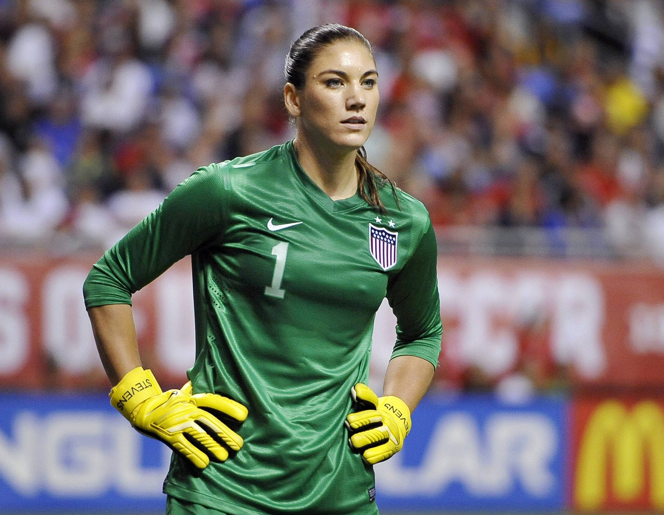 In this Oct. 20, 2013, file photo, United States goalkeeper Hope Solo, shown here in 2013, was arrested early Saturday morning at her suburban Seattle home, police said. She is accused of assaulting her sister and nephew.