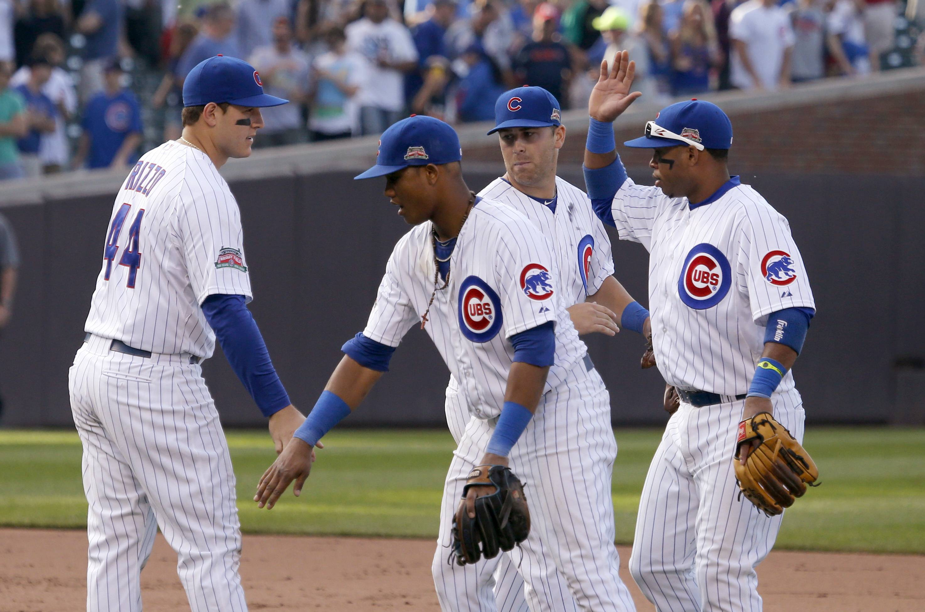 Chicago Cubs players, from left, Anthony Rizzo, Starlin Castro, Mike Olt and Luis Valbuena celebrate the team's 6-3 win over the Pittsburgh Pirates on Friday.