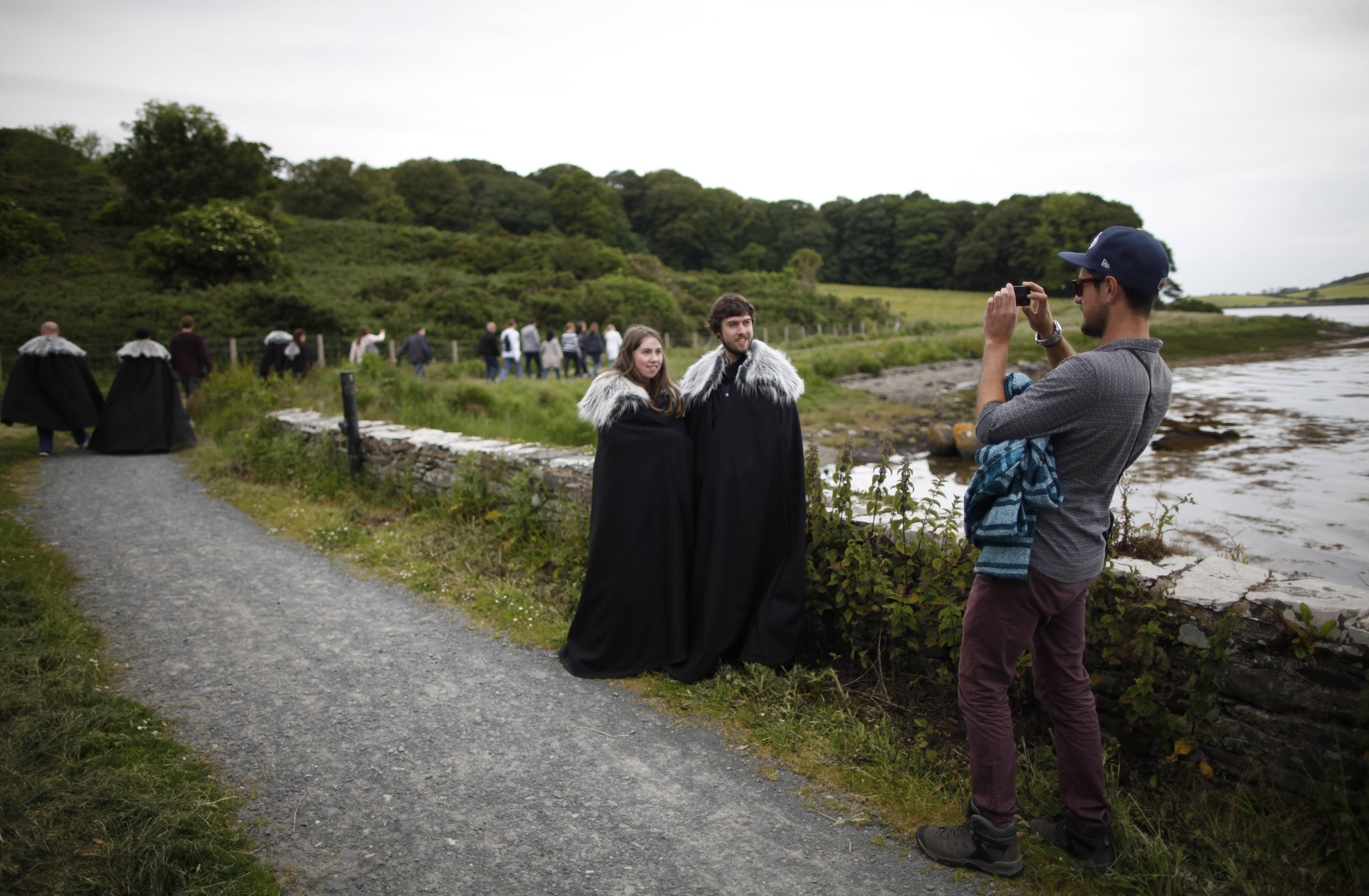 Game of Thrones fans stop for a picture on their way to Audleys field and castle in Strangford, Northern Ireland. Audleys field and castle was used for filming season 1 as King Robert Baratheon and his retinue arrive at Winterfell.
