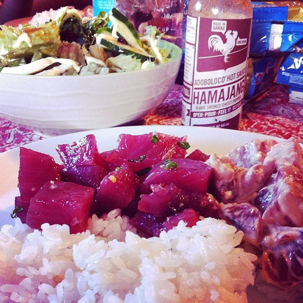 "This undated photo provided by Tim Parsons and posted in May 2014 to the Instagram account of his company, Adoboloco, features one of his products, Hamajang Hot Sauce, with fresh homemade Aku Poke. ""We use Instagram to show what we're doing in our lives and outside of the business,"" says Parsons."