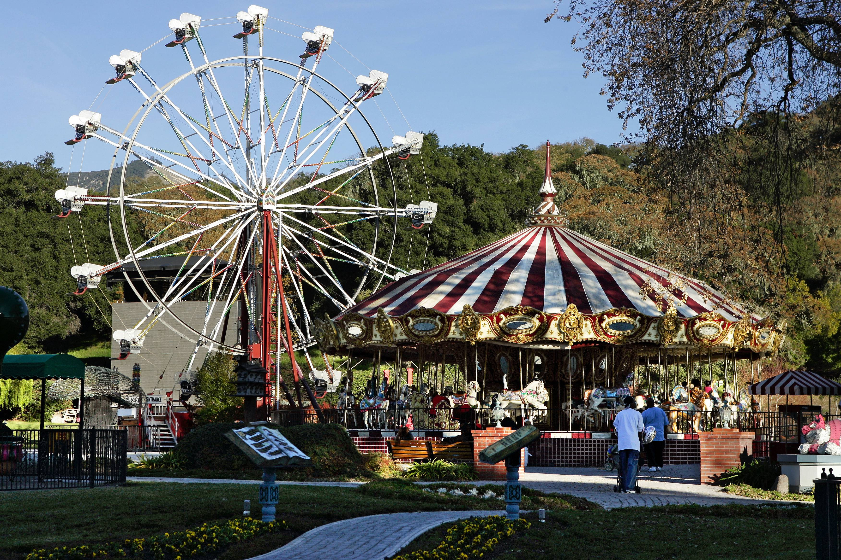 A carousel and ferris wheel dominate Michael Jackson's Neverland Ranch home in Santa Ynez, Calif. In 2014, Jackson's playtime palace sits empty now. The backyard circus and laughter of children are long gone, but the house and its fanciful memories live on.