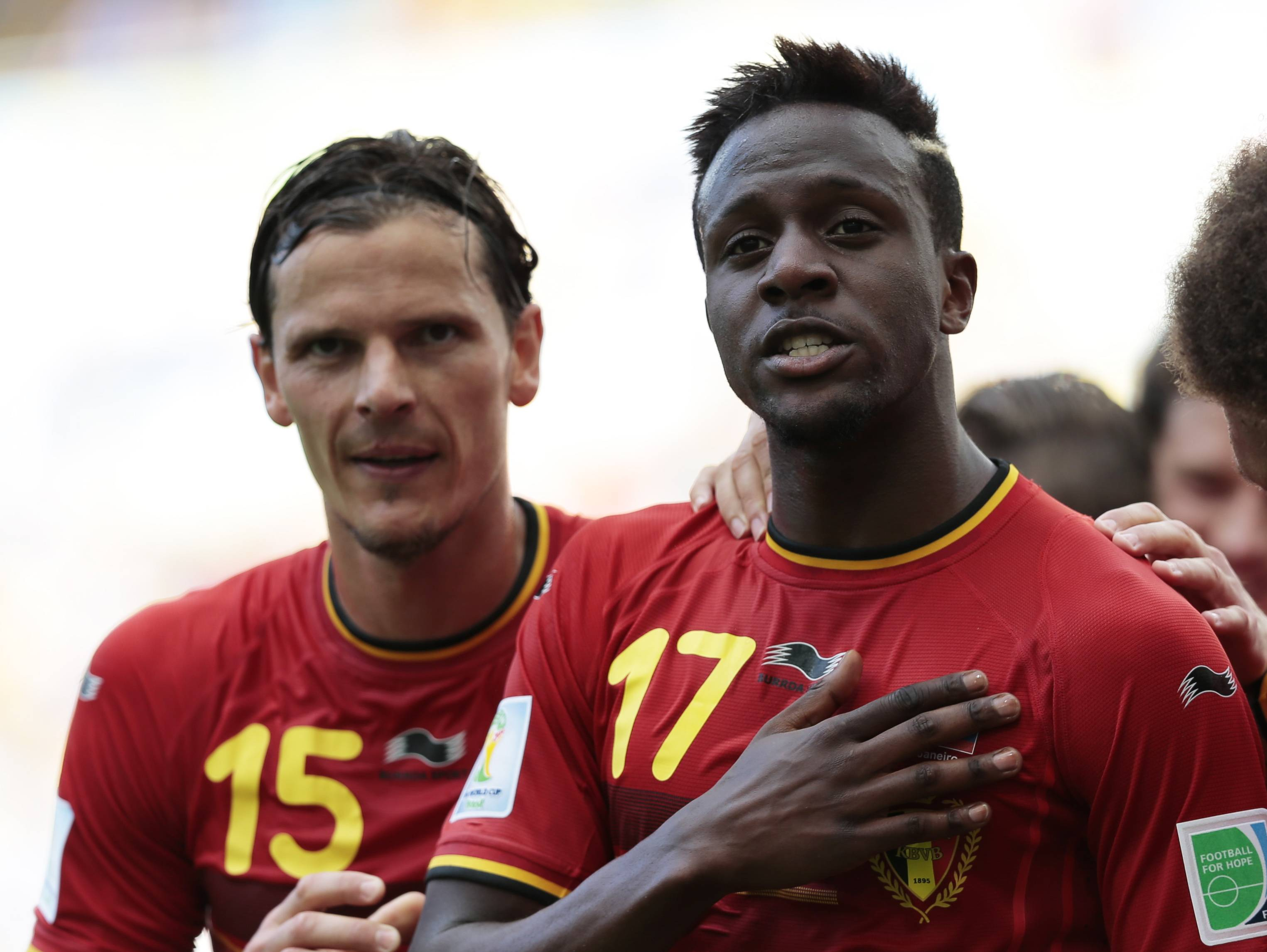 Belgium's Divock Origi, right, celebrates with Belgium's Daniel Van Buyten after Origi scored the opening goal during the group H World Cup soccer match between Belgium and Russia at the Maracana stadium in Rio de Janeiro, Brazil, Sunday.
