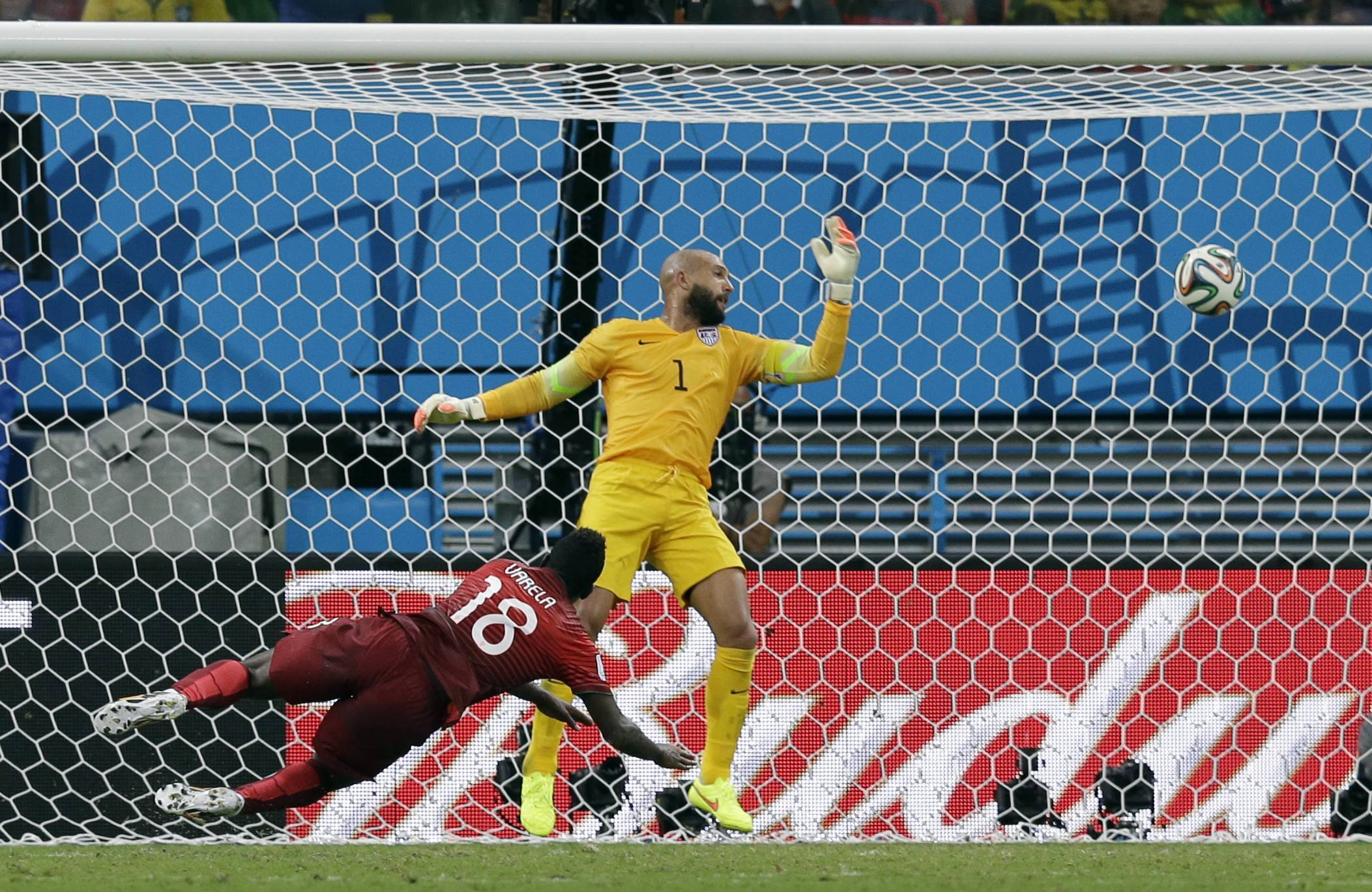 Portugal's Silvestre Varela heads the ball past United States goalkeeper Tim Howard to score his side's second goal Sunday and tie the game at 2-2 during the group G World Cup soccer match between the USA and Portugal at the Arena da Amazonia in Manaus, Brazil.