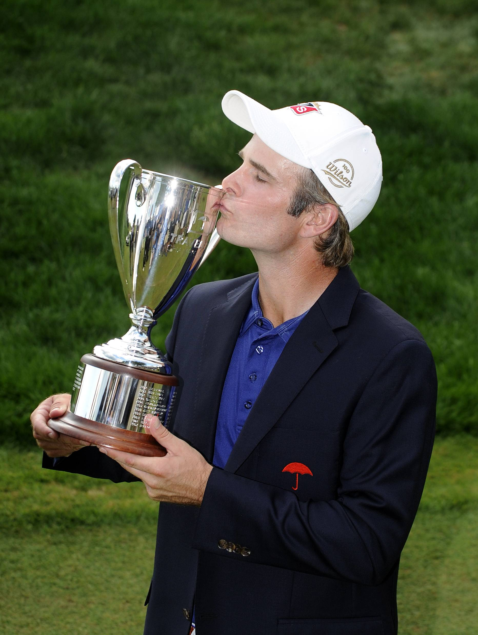 Kevin Streelman kisses the trophy Sunday after winning the Travelers Championship golf tournament in Cromwell, Conn. Streelman finished his round with seven straight birdies to win the tournament at 15-under par.