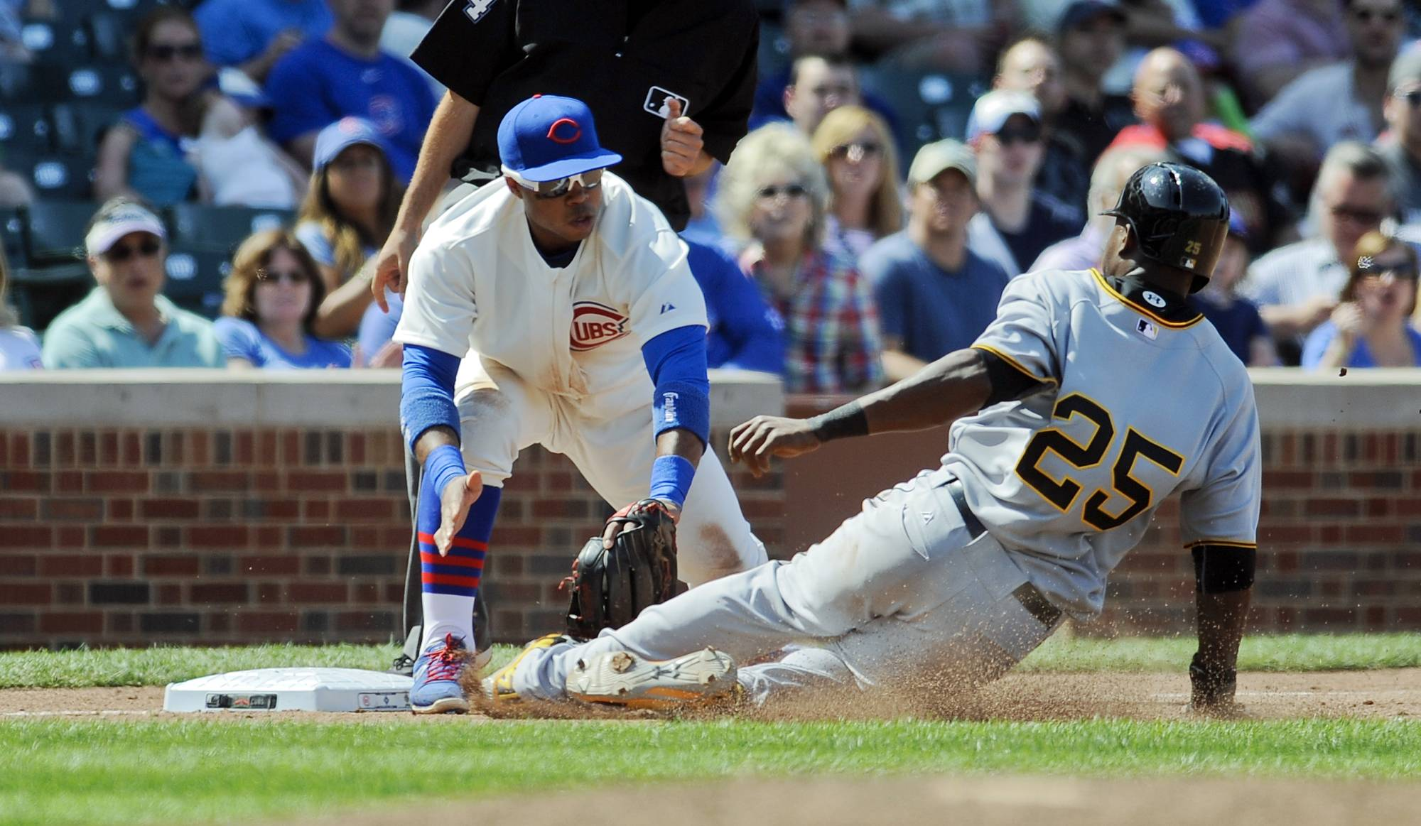 Chicago Cubs third baseman Luis Valbuena makes a tag on Pittsburgh Pirates right fielder Gregory Polanco during the eighth inning of a baseball game on Sunday, June 22, 2014, in Chicago.
