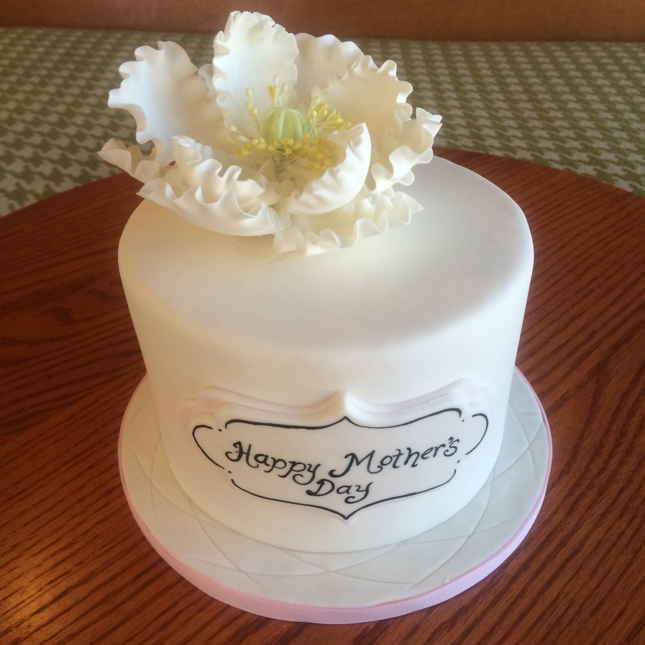 This undated photo provided by Tiffany Jones and posted in May 2014 to the Instagram account of her company, Peridot Sweets Las Vegas, shows a Mother's Day cake. Jones says she sold seven of the cakes to people who saw the photo on Instagram. The photo also automatically posted to the company's Facebook page, which is followed by nearly 1,200. She sold six more cakes to Facebook fans.