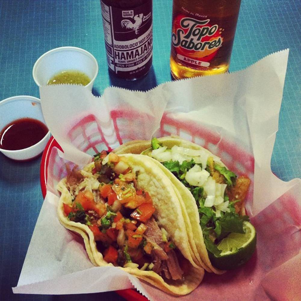 This undated photo provided by Tim Parsons and posted in June 2014 to the Instagram account of his company, Adoboloco, shows his product with tacos at La Tienda Del Sol in Kihei, Hawaii.