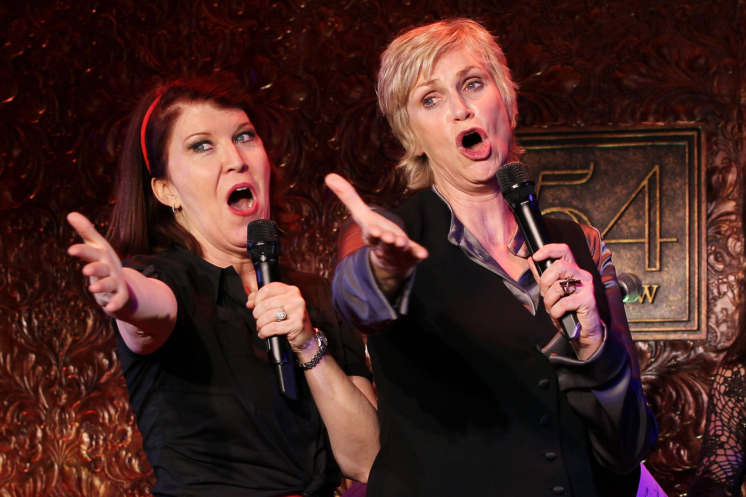 Actor Kate Flannery, left, and Jane Lynch perform for the press before Lynch's concert debut at 54 Below in New York on Wednesday.
