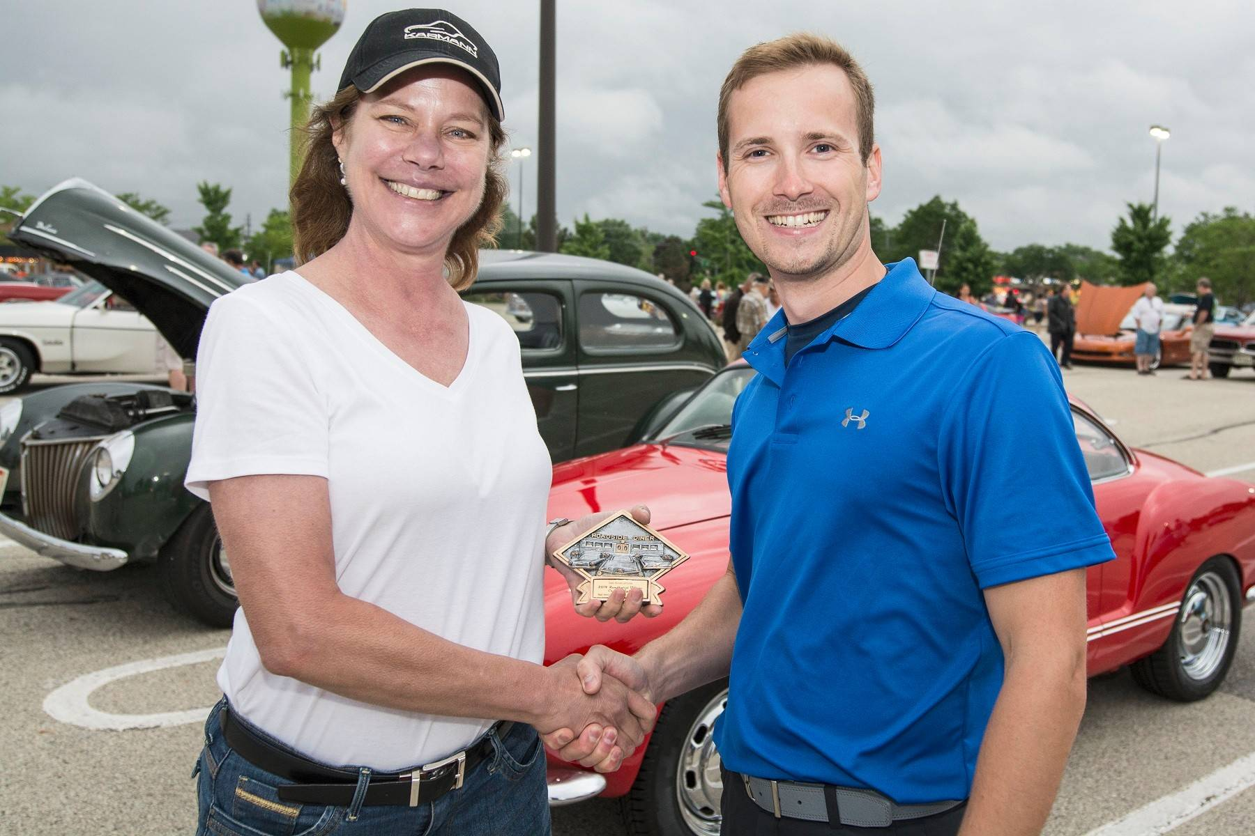 Gail Goldsmith of Palatine receives the Classic Car Champion award from Matthew Avery.