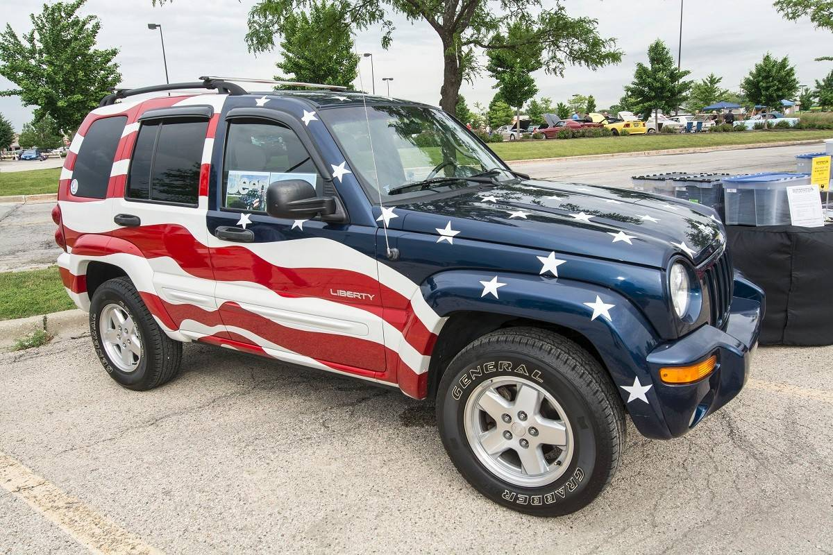 Nick Priola brought his 2002 Jeep Liberty, one of four by artist Paul Clawson commissioned by United Auto Workers and Chrysler in remembrance of Sept. 11. Clawson worked as a paint artist at the Toledo, Ohio, Jeep plant.