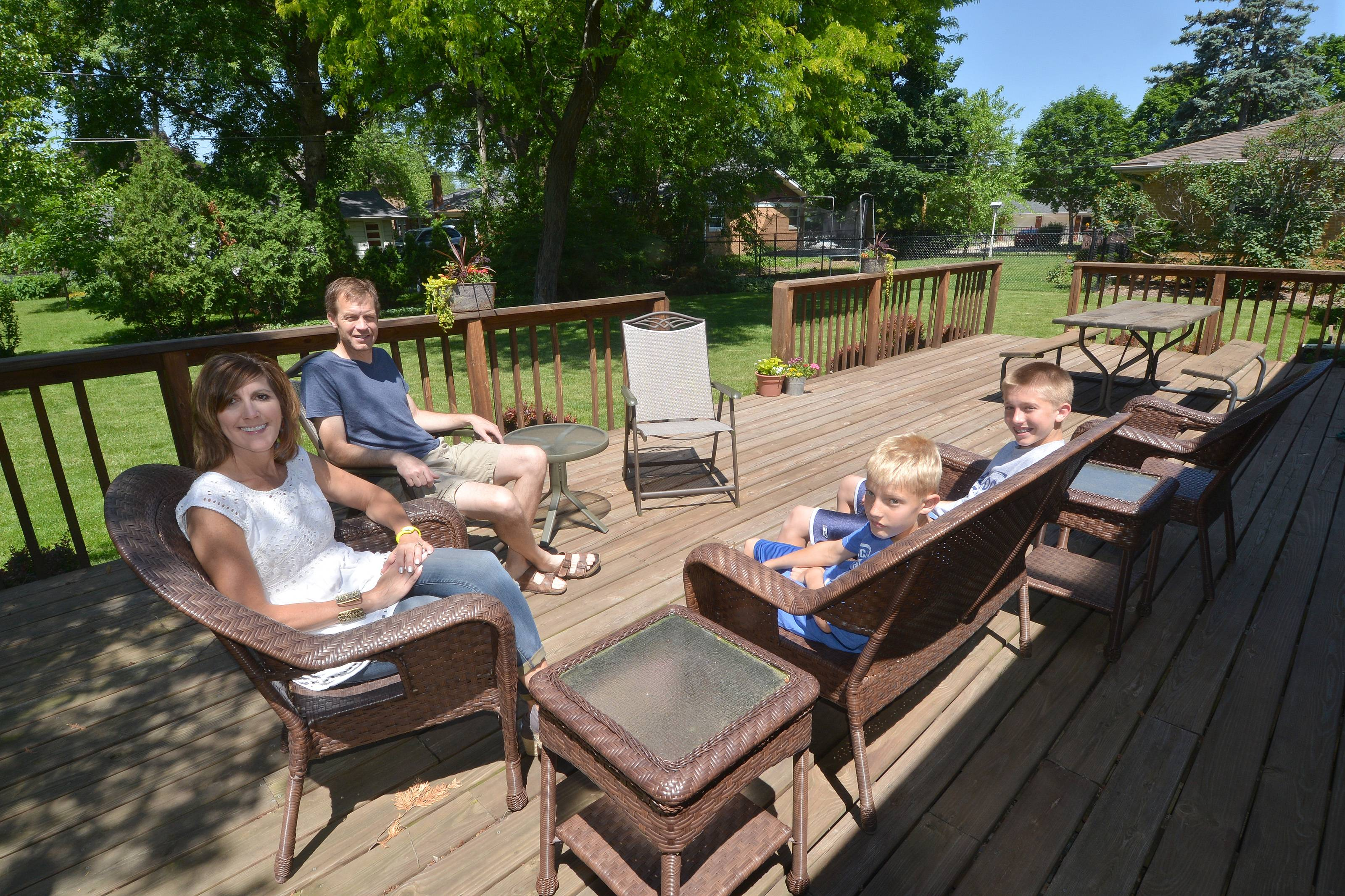 Susan Sampson, of Itasca, placed second in the Get your Summer On makeover contest. The family will be getting a makeover for the deck of their house this summer. From left: Susan Sampson, Pete Sampson, Jack Sampson, and Bob Sampson. Not pictured is Anna Sampson.