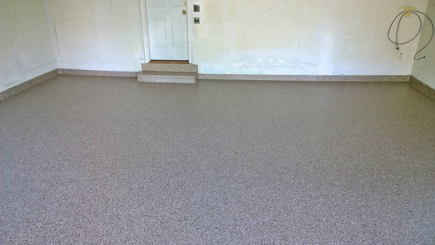 The Eglund's garage floor after a slip-resistant polymer floor was installed by Garage Store.