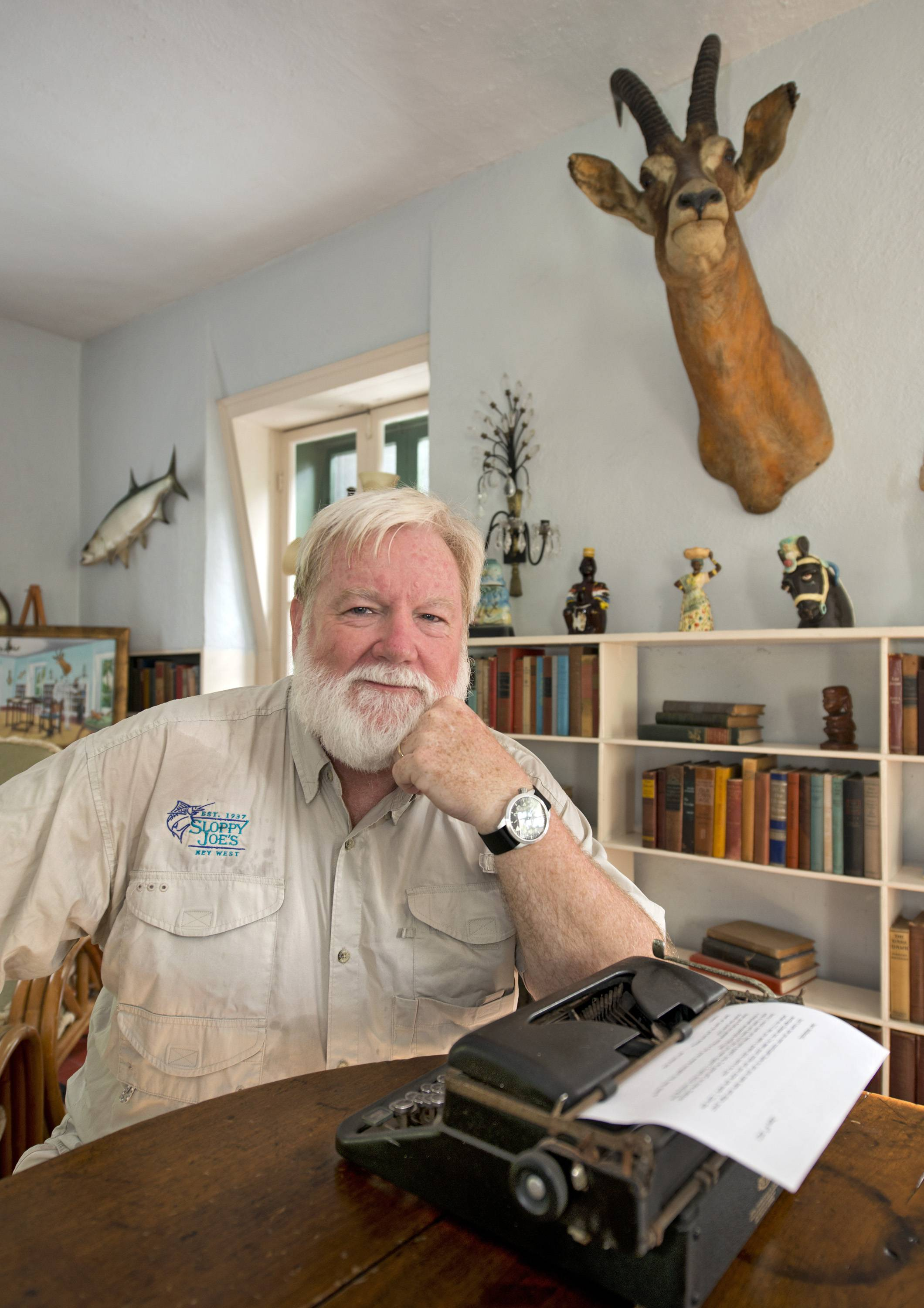 Stephen Terry, sitting in Ernest Hemingway's one-time study at the Hemingway Home and Museum in Key West, Fla., beat 125 other contestants in the 2013 Ernest Hemingway look-alike contest during Key West's annual Hemingway Days celebrating the anniversary of the author's birth.