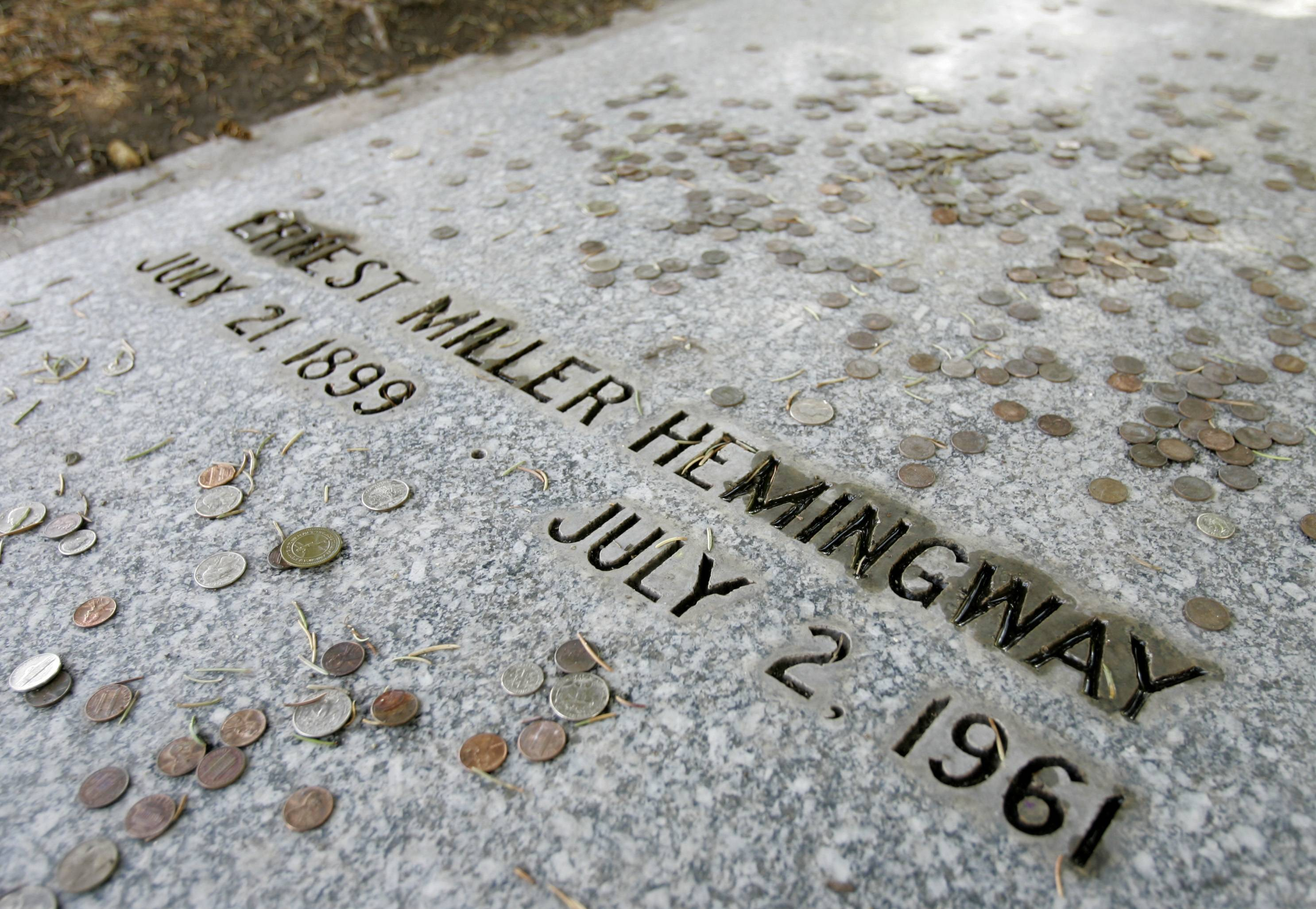 Coins left by visitors remain on the grave of Ernest Hemingway in Ketchum, Idaho. The house nearby in Ketchum that was owned by the famed novelist now belongs to the Nature Conservancy as part of a private preserve.