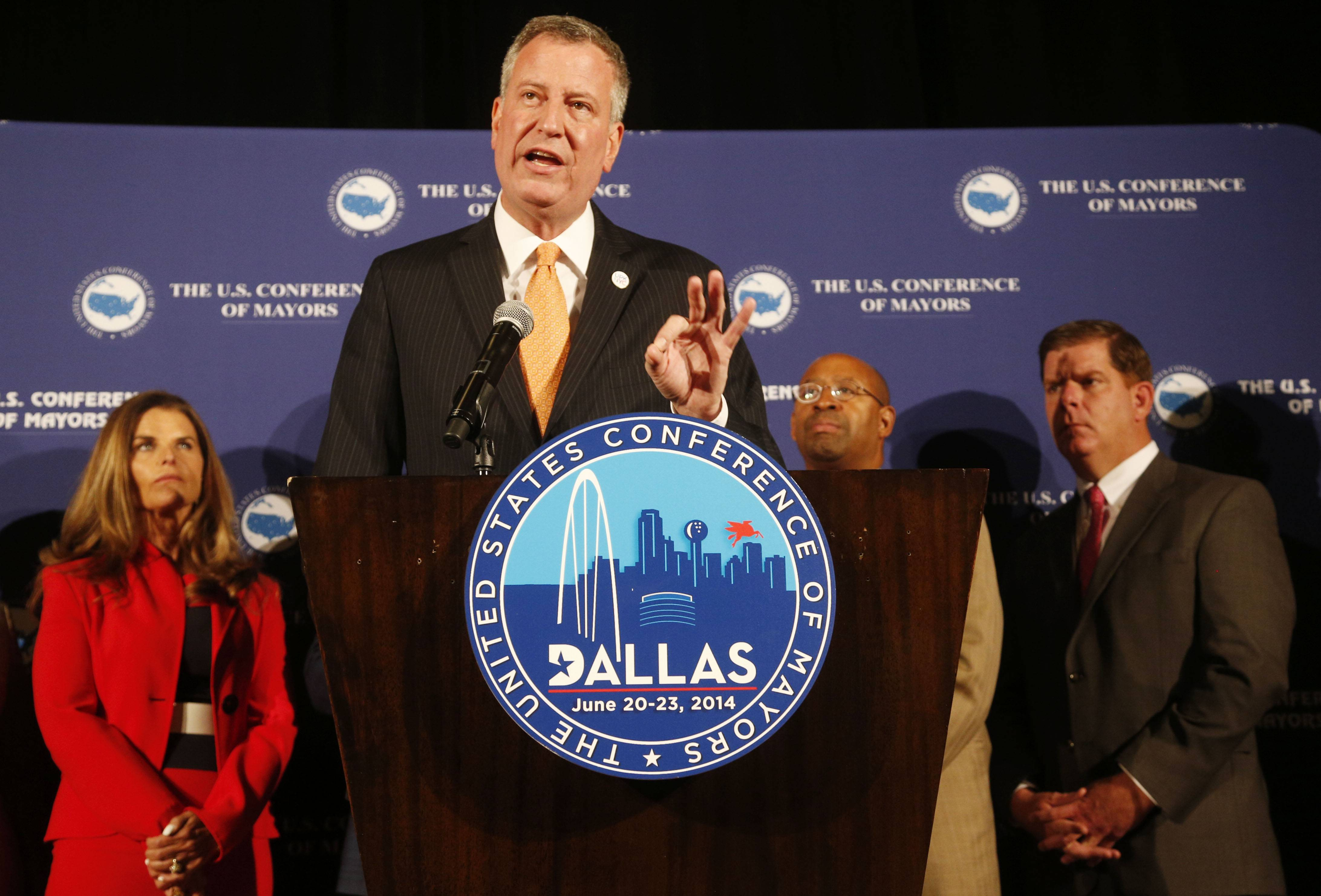 New York City mayor Bill de Blasio, speaks during a press conference announcing a new effort to focus attention on helping end inequality in American cities at the U.S. Conference of Mayors in Dallas on Sunday. Others attending were, from left, Maria Shriver, Philadelphia Mayor Michael A. Nutter and Boston Mayor Martin J. Walsh.