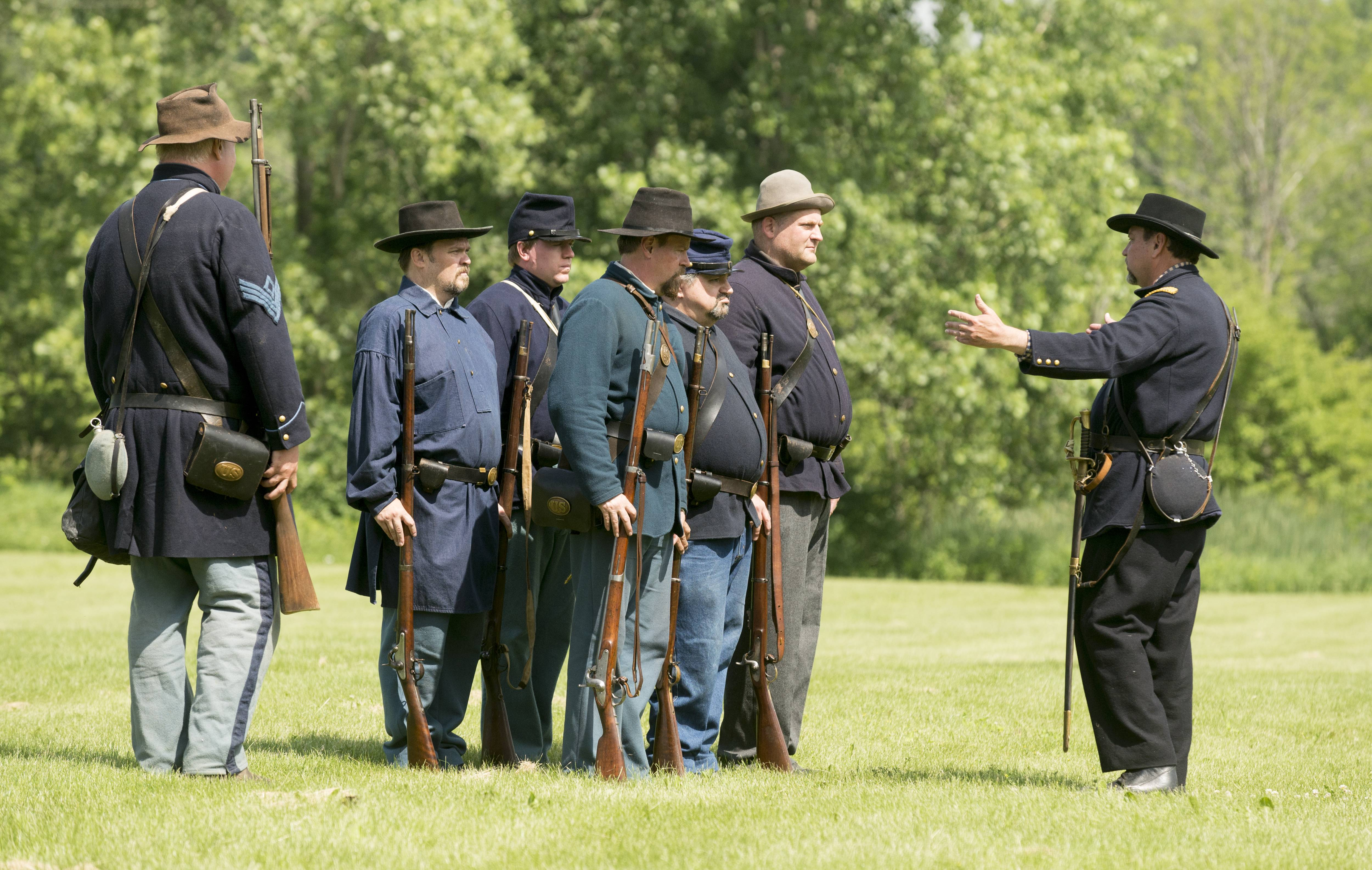 The 10th Illinois Volunteer Regiment performs a manual of arms drills Sunday during the second annual Civil War Days at Fischer Farm in Bensenville.