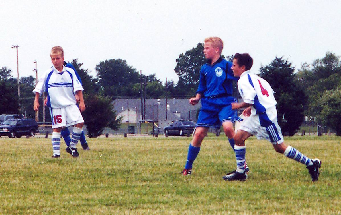 Michael Bradley (in blue) as a youth soccer player in Palatine. Bradley might not have had the best skill set, but he worked hard to hone his craft, says his former coach David Richardson.