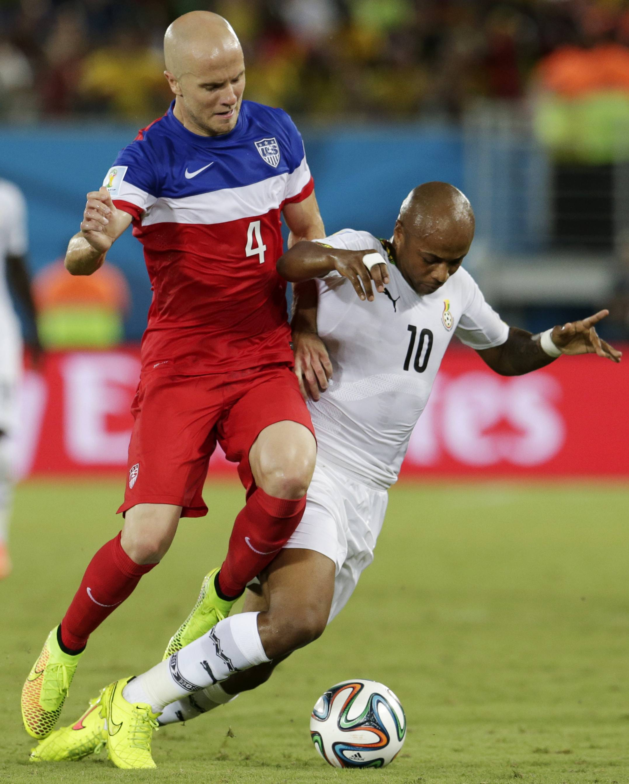 Midfielder Michael Bradley, left, pushes Ghana's Andre Ayew away from the ball during the U.S.'s 2-1 win June 16 in Brazil. Bradley admitted the Ghana match wasn't his best game and said he must be much sharper against Portugal tonight.