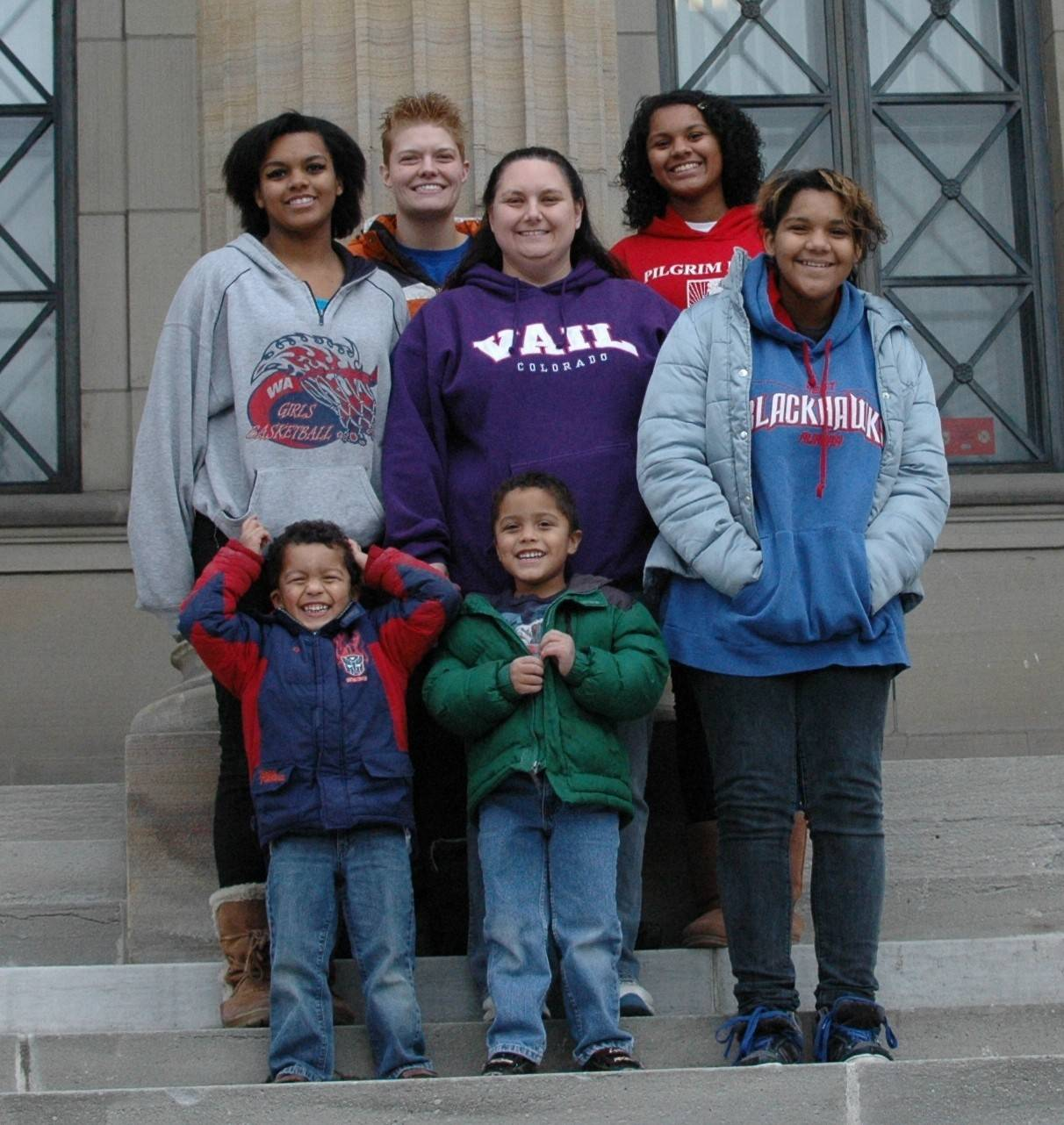 All smiles after getting their marriage license in 2011 in Niagara Falls, N.Y., Aurora moms Beth Keenan, in Vail shirt, and Geneva Fry, left on upper row, boast a family of daughters, from left to right, Mary, Katherine and Adriana, and twin sons, Logan, left, and Toby.