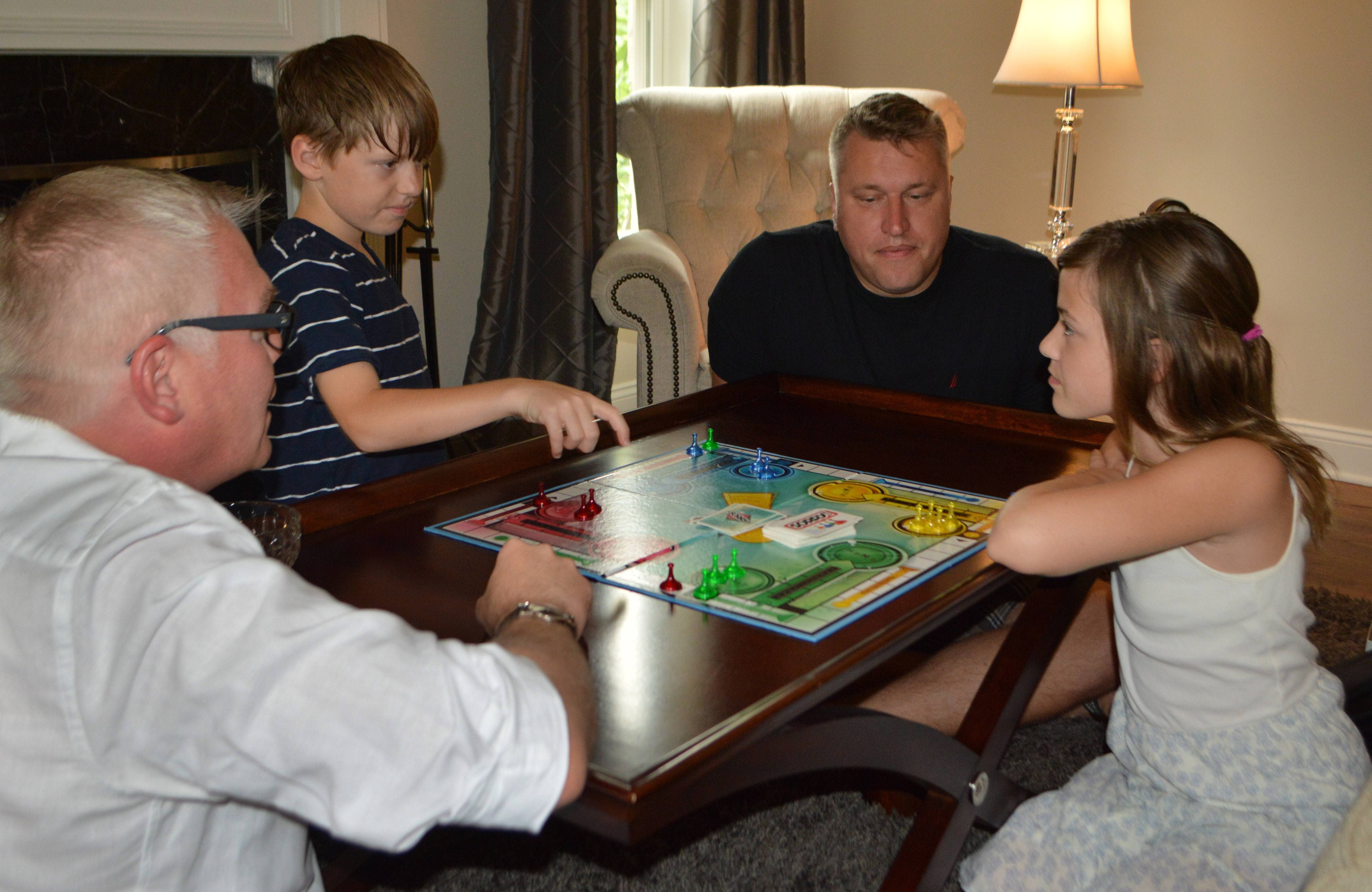 "Family game night is a tradition with parents David, left, and Lee Neubecker, playing ""Sorry"" here with son Michael and daughter Braiden. The kids lobbied on behalf of gay marriage and delivered the rings for their dads' wedding on Saturday."