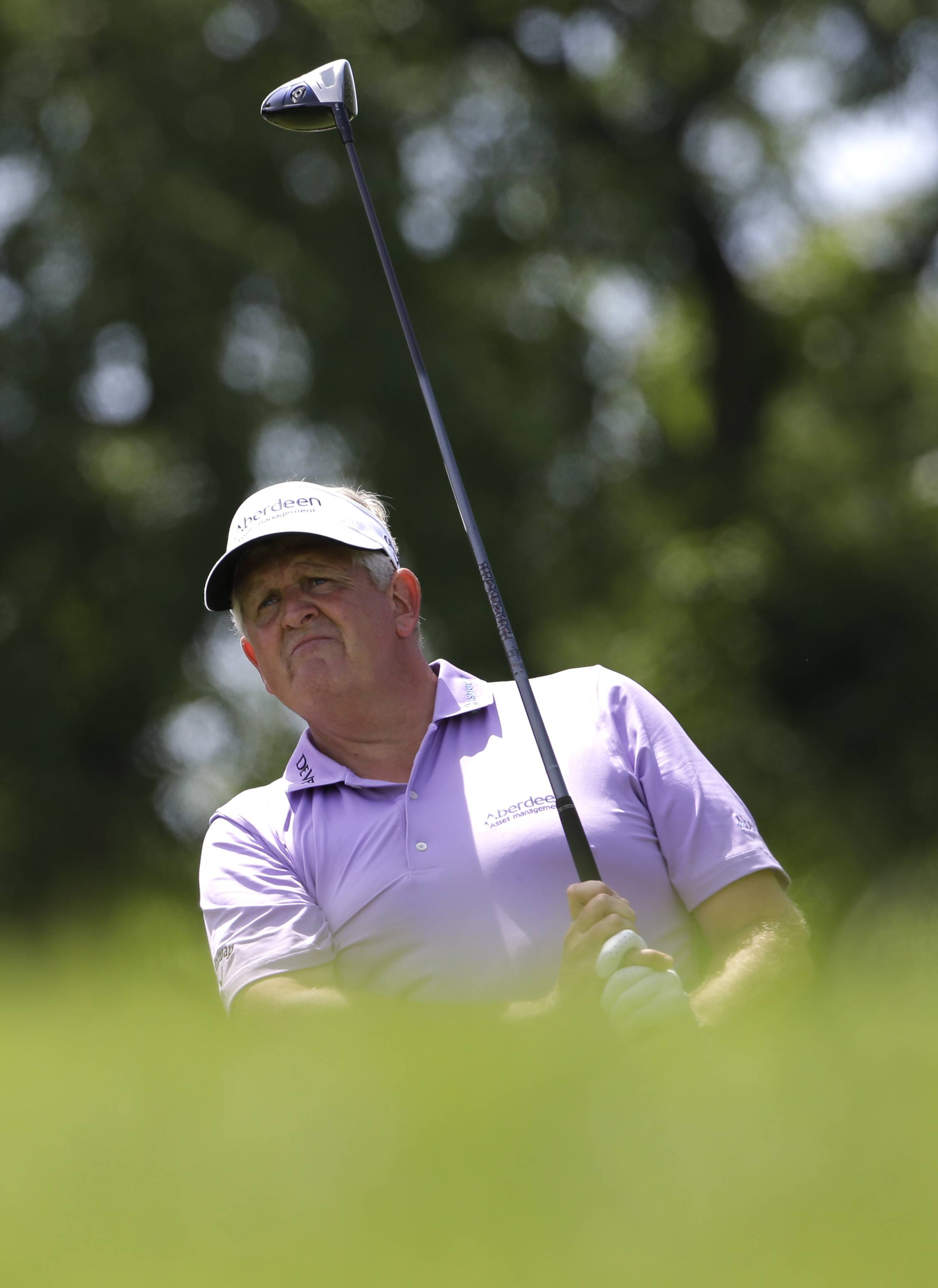 Colin Montgomerie watches his tee shot on the third hole during the final round of the Encompass Championship golf tournament in Glenview, Ill., Sunday, June 22, 2014.