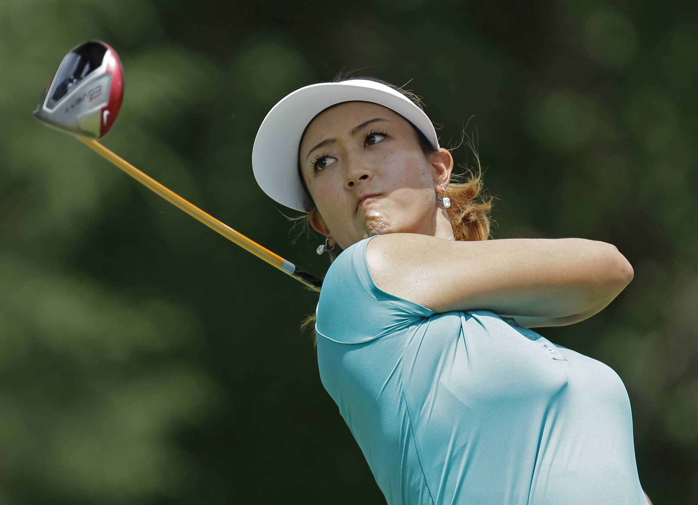Michelle Wie watches her tee shot on the seventh hole during the final round of the U.S. Women's Open golf tournament in Pinehurst, N.C., Sunday, June 22, 2014.