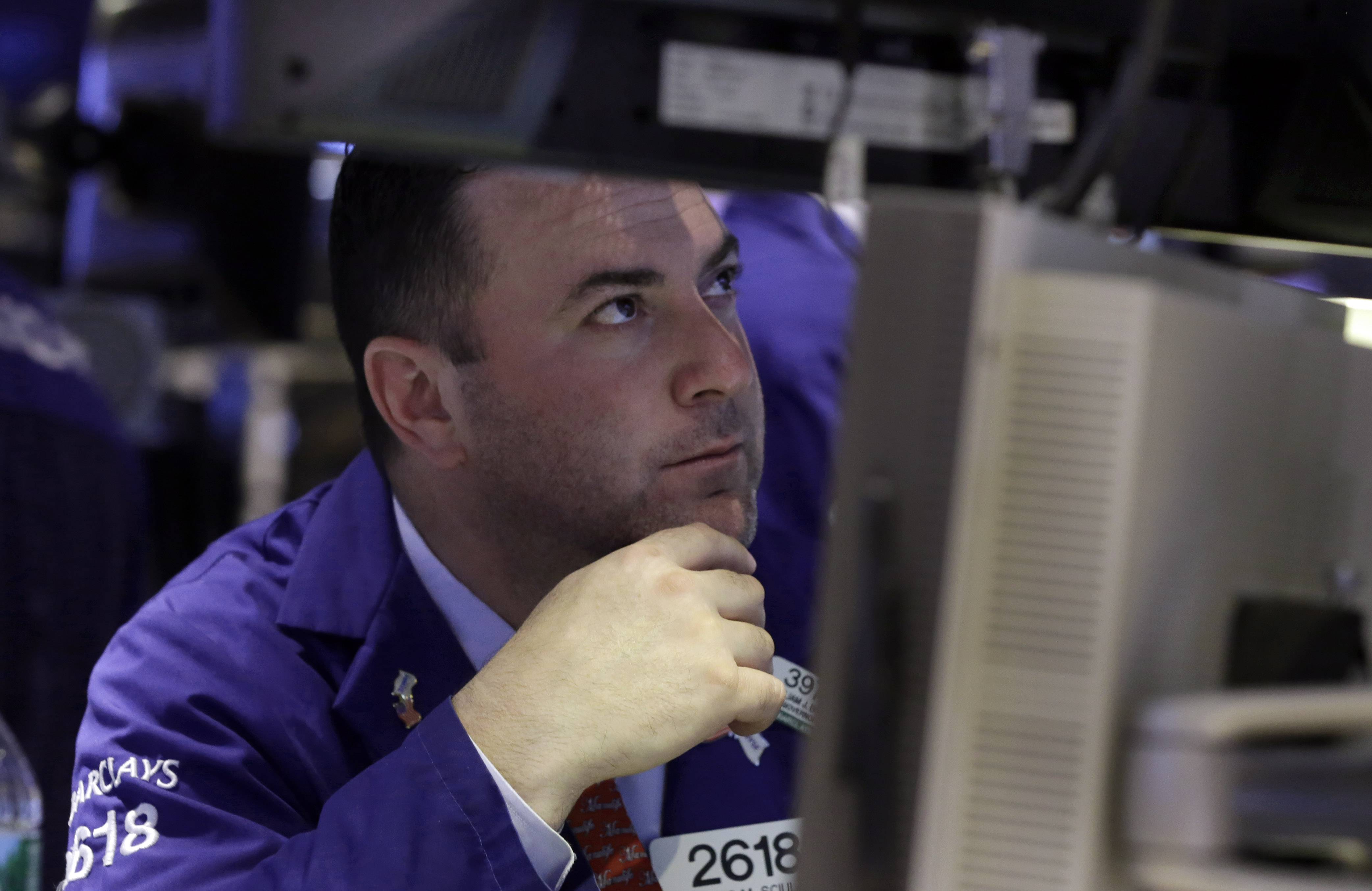 U.S. stock indexes ended slightly below the record levels they reached last week as investors assessed news from big corporations. Wisconsin Energy fell 4 percent and General Electric fell 1 percent after the companies said they had made acquisitions. The Standard & Poor's 500 index fell a fraction of a point.