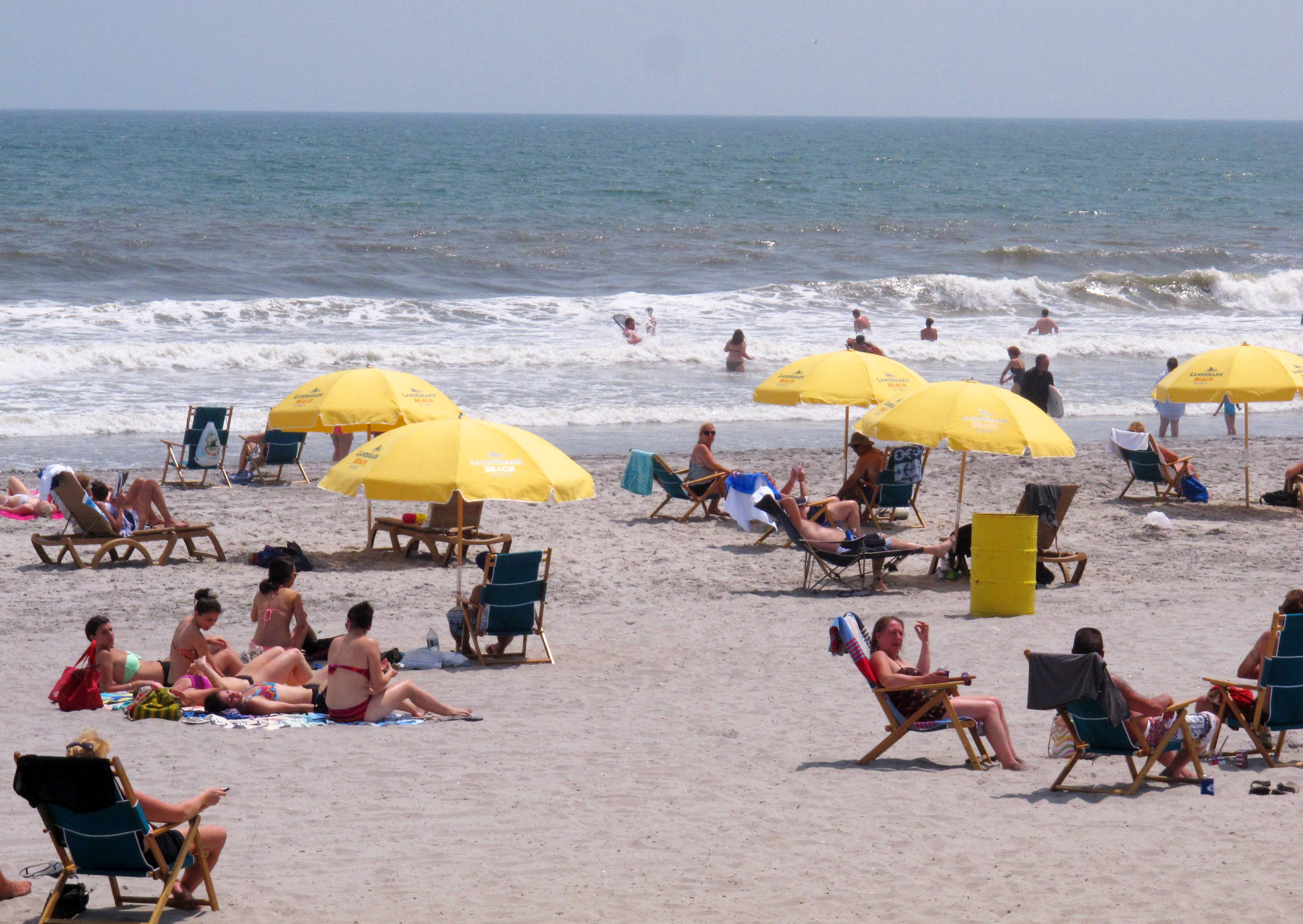 Beachgoers enjoy a sunny day on the beach in Atlantic City, N.J. The city is one of five Jersey shore beach towns that don't require visitors to buy beach badges.