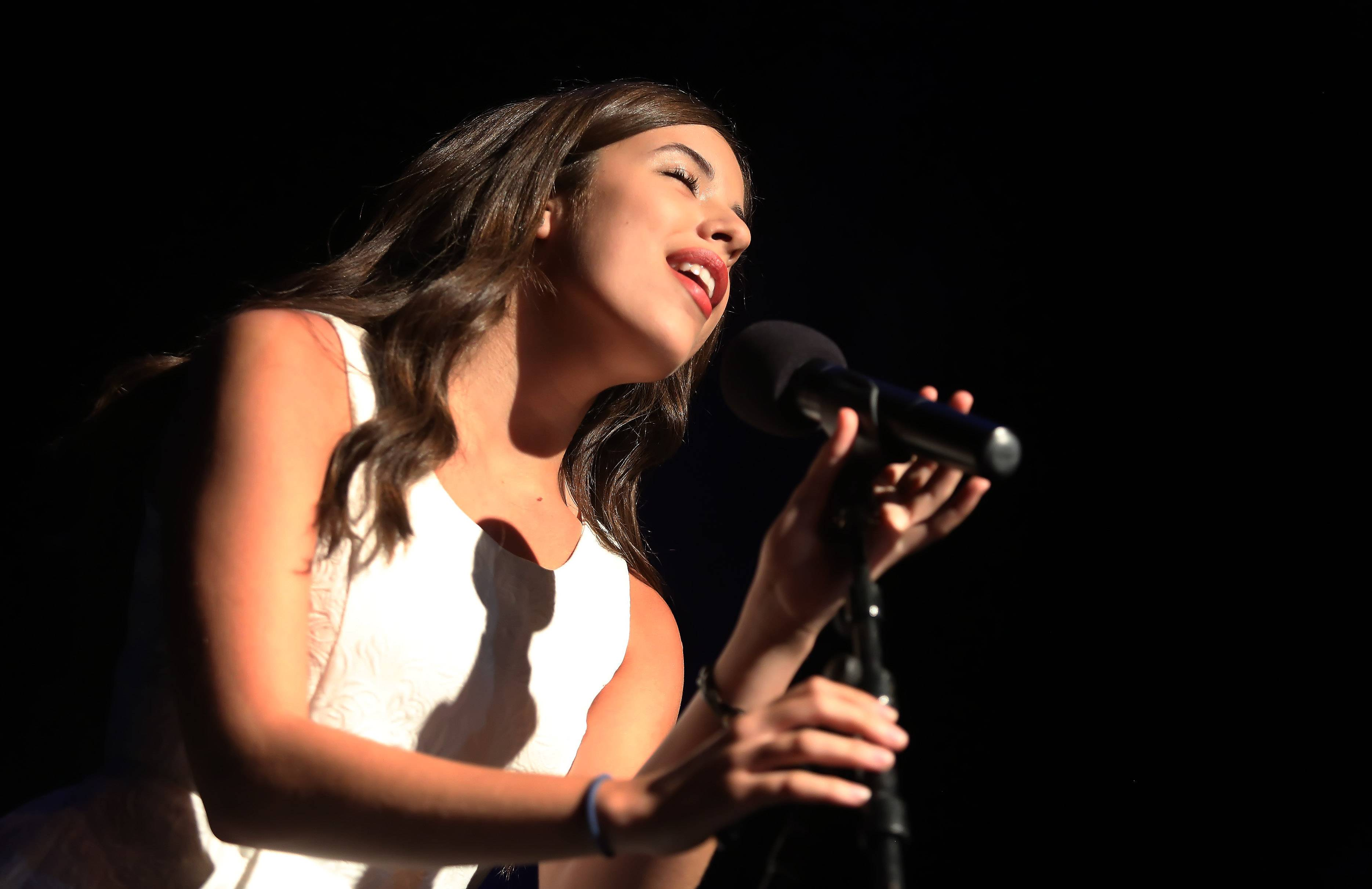 Alyssa Peterson of Hoffman Estates sings during Sunday's performance of the top 20 finalists of the Suburban Chicago's Got Talent competition Sunday at the Prairie Center for the Arts in Schaumburg.