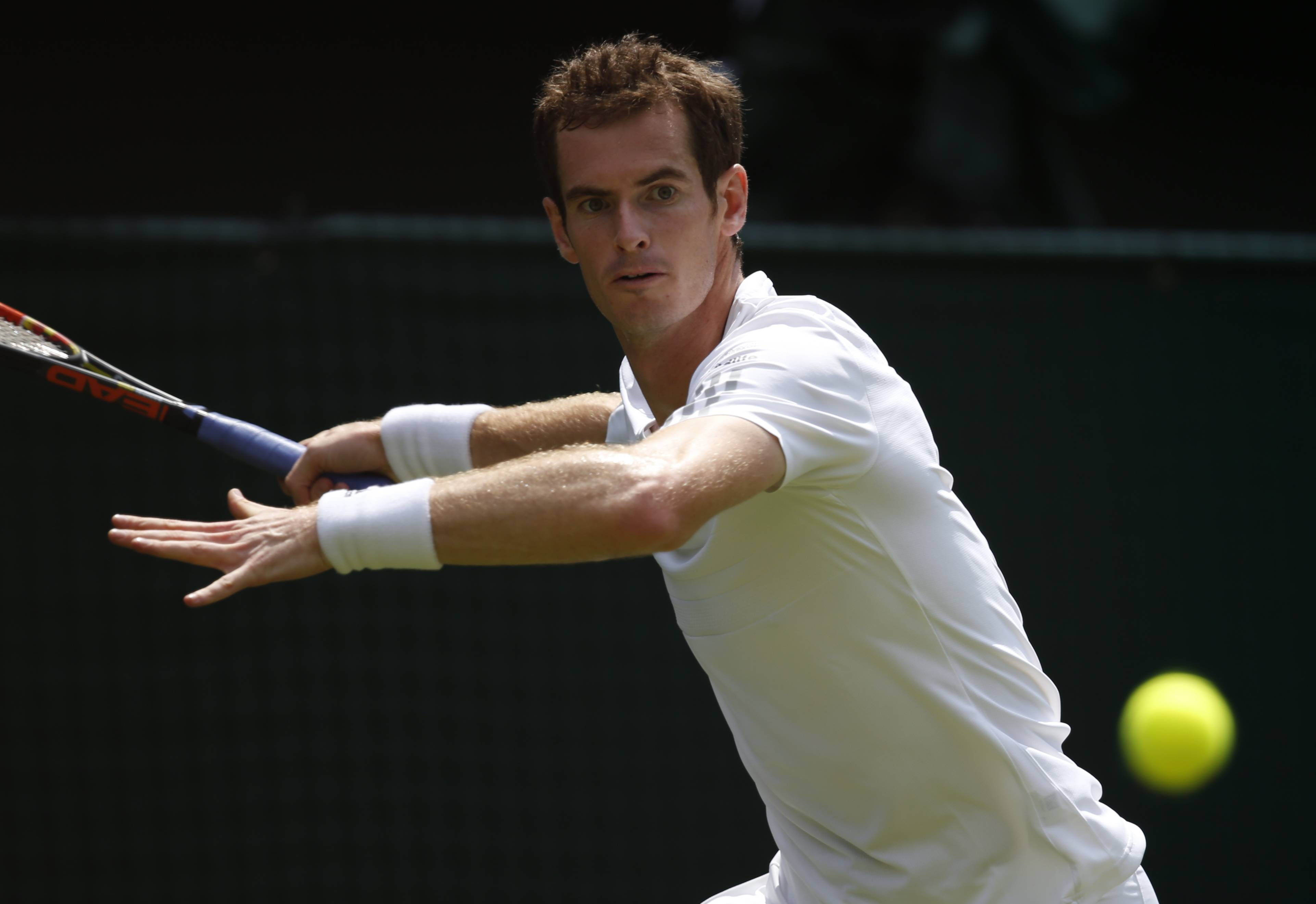 Andy Murray plays a return to David Goffin Monday during their first round match at Wimbledon.