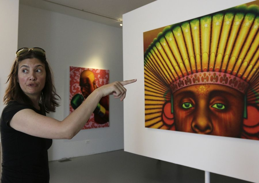 "Vesna K. Stelcer, board chair of the Ed Paschke Foundation, explains a painting titled ""American Sueno"" by Ed Paschke that's on display at the Ed Paschke Art Center."