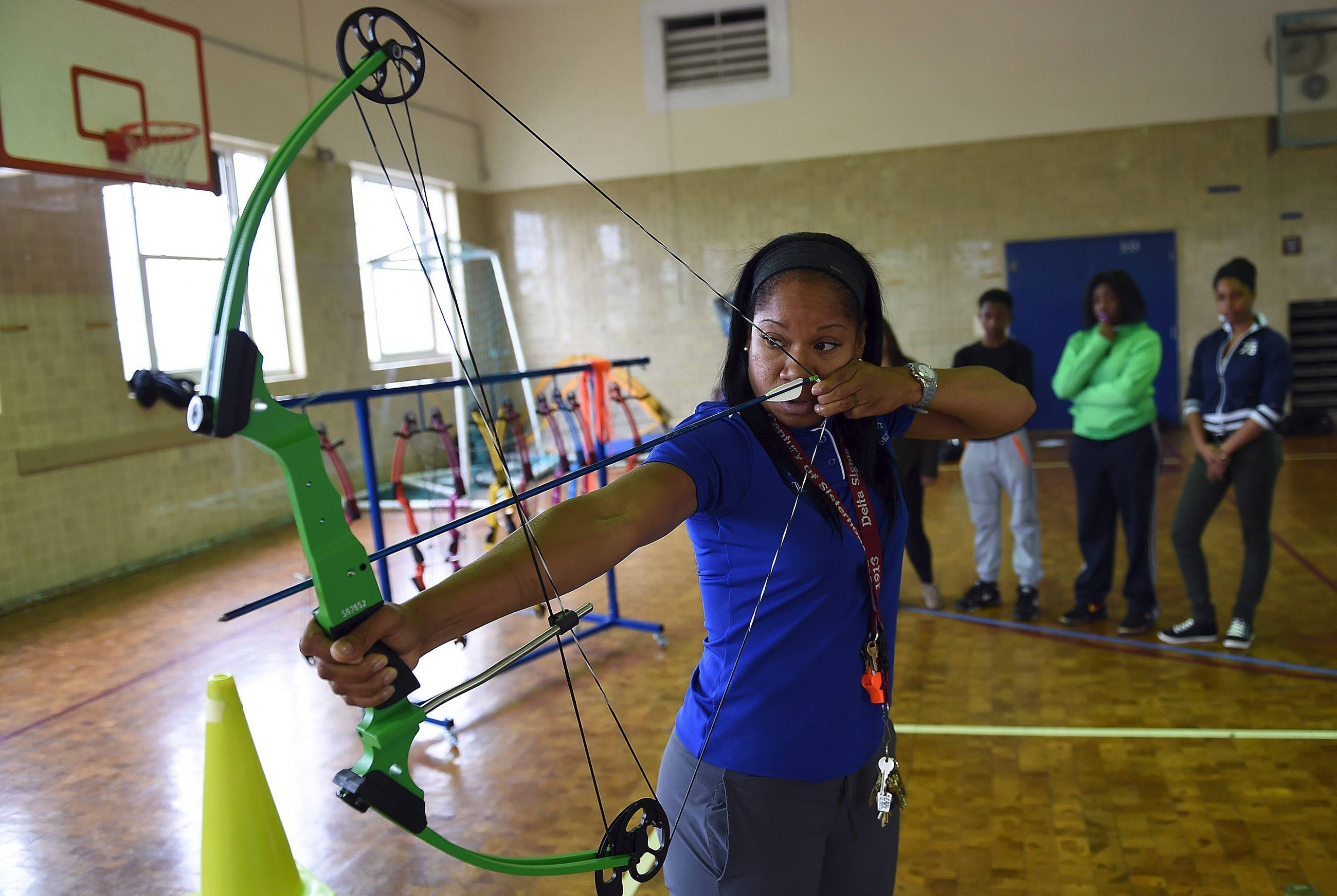 Miesha Thompson teaches archery to students at Roosevelt High School in Washington.