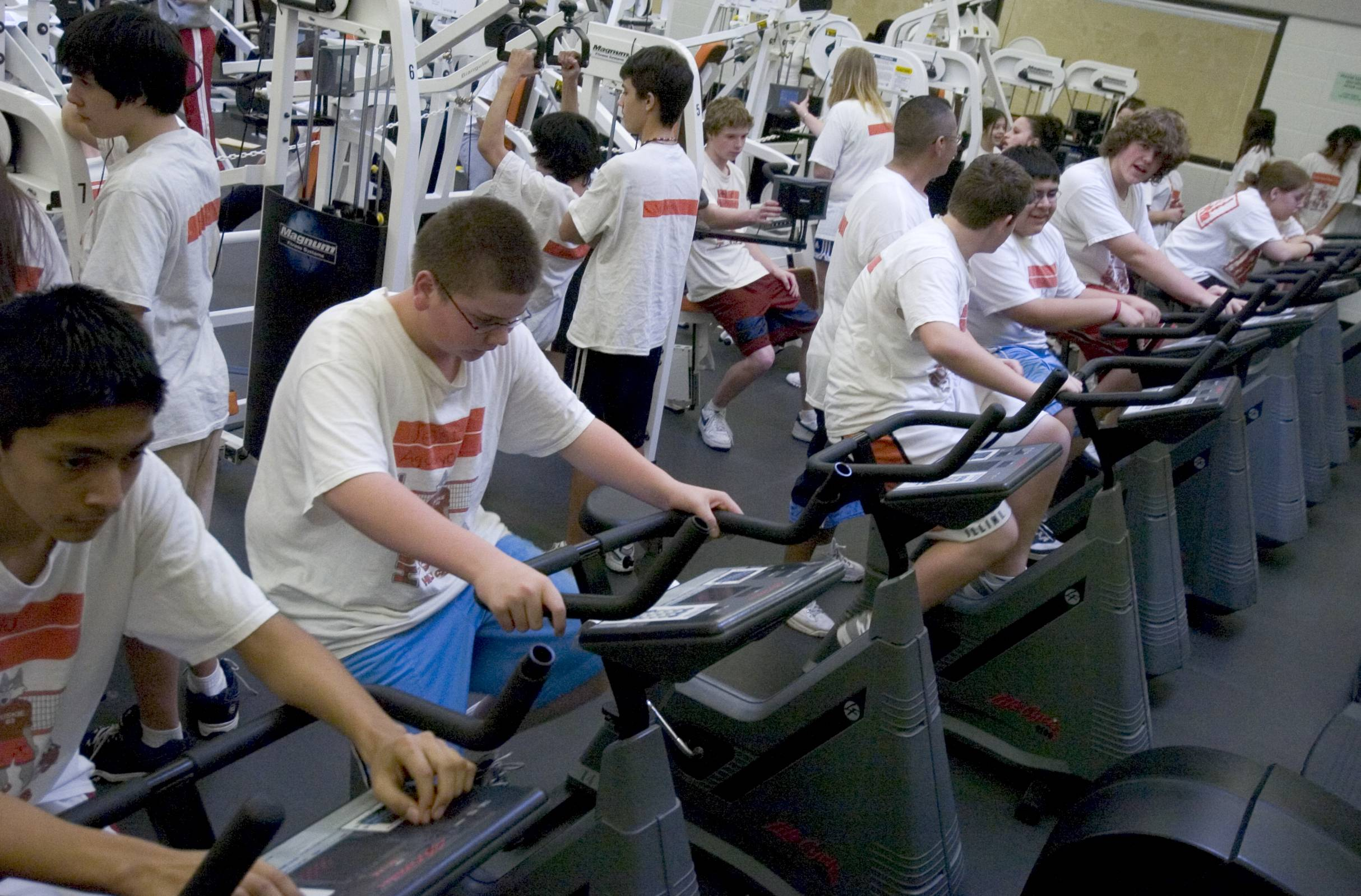 "In this file photo, Hersey High School students do a cardio workout while others work with weights. The ""New P.E."" focuses on personal fitness plans and target heart-rate zones."