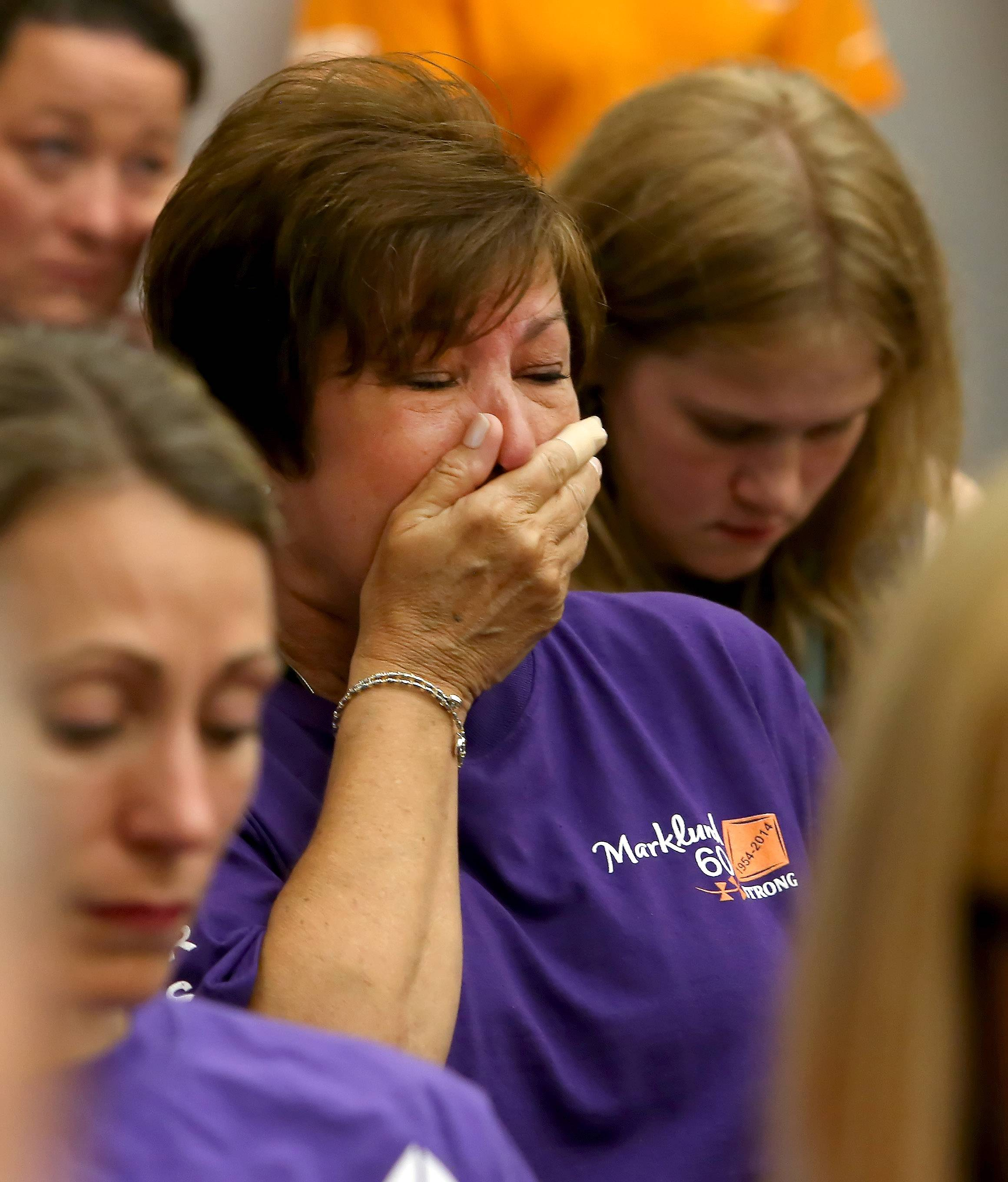 Susan Semla of Bloomingdale, who has an autistic daughter, gets emotional as another mother of an autistic child speaks Monday during Bloomingdale's village board meeting. Residents spoke for and against Marklund's proposal to expand its school for autism.