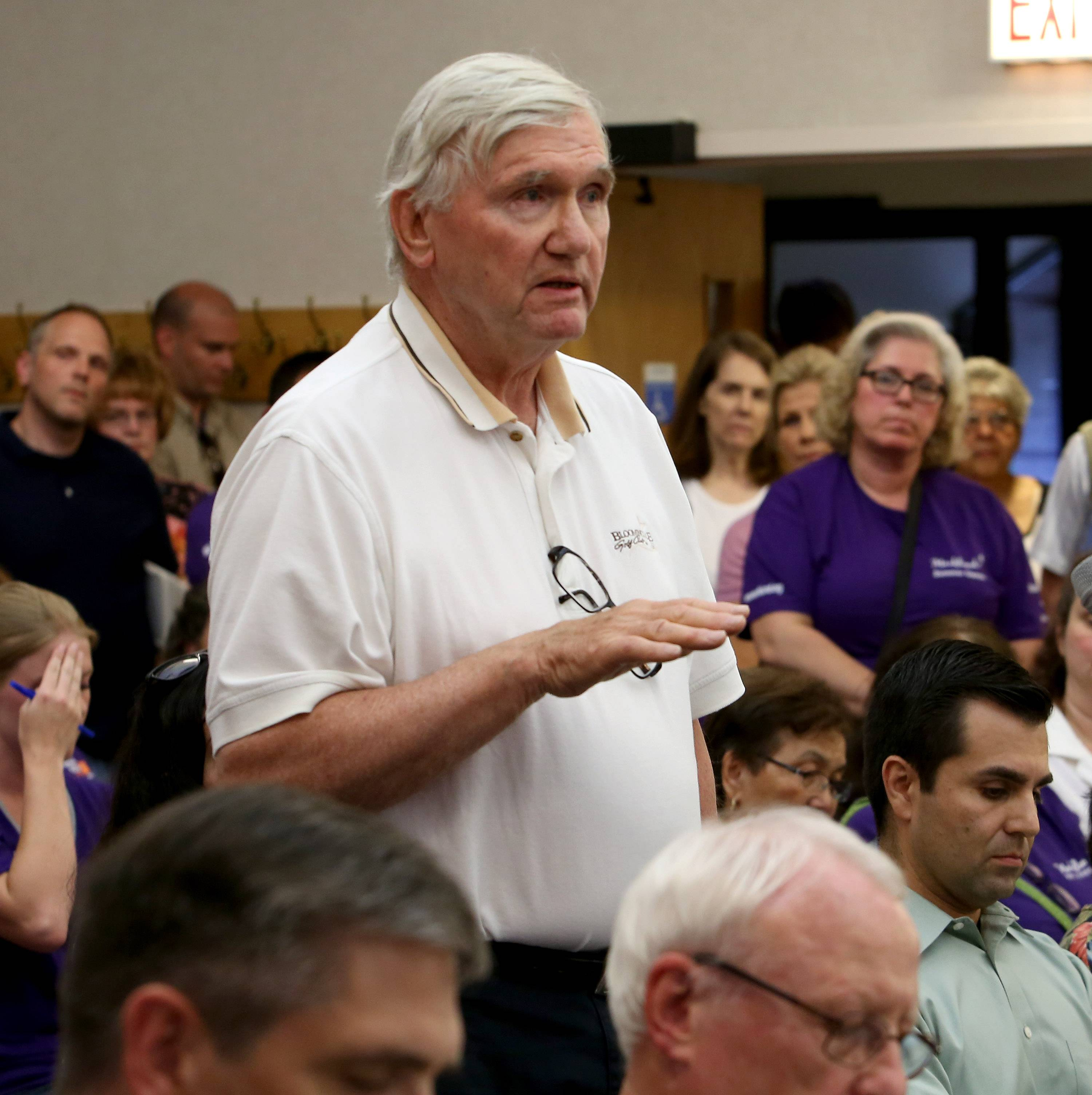 Norm VanMaldegiam speaks out against the expansion of Marklund during Bloomingdale's village board meeting on Monday. VanMaldegiam, who lives on Prairie Avenue, is concerned about the number of buses and traffic in the area.