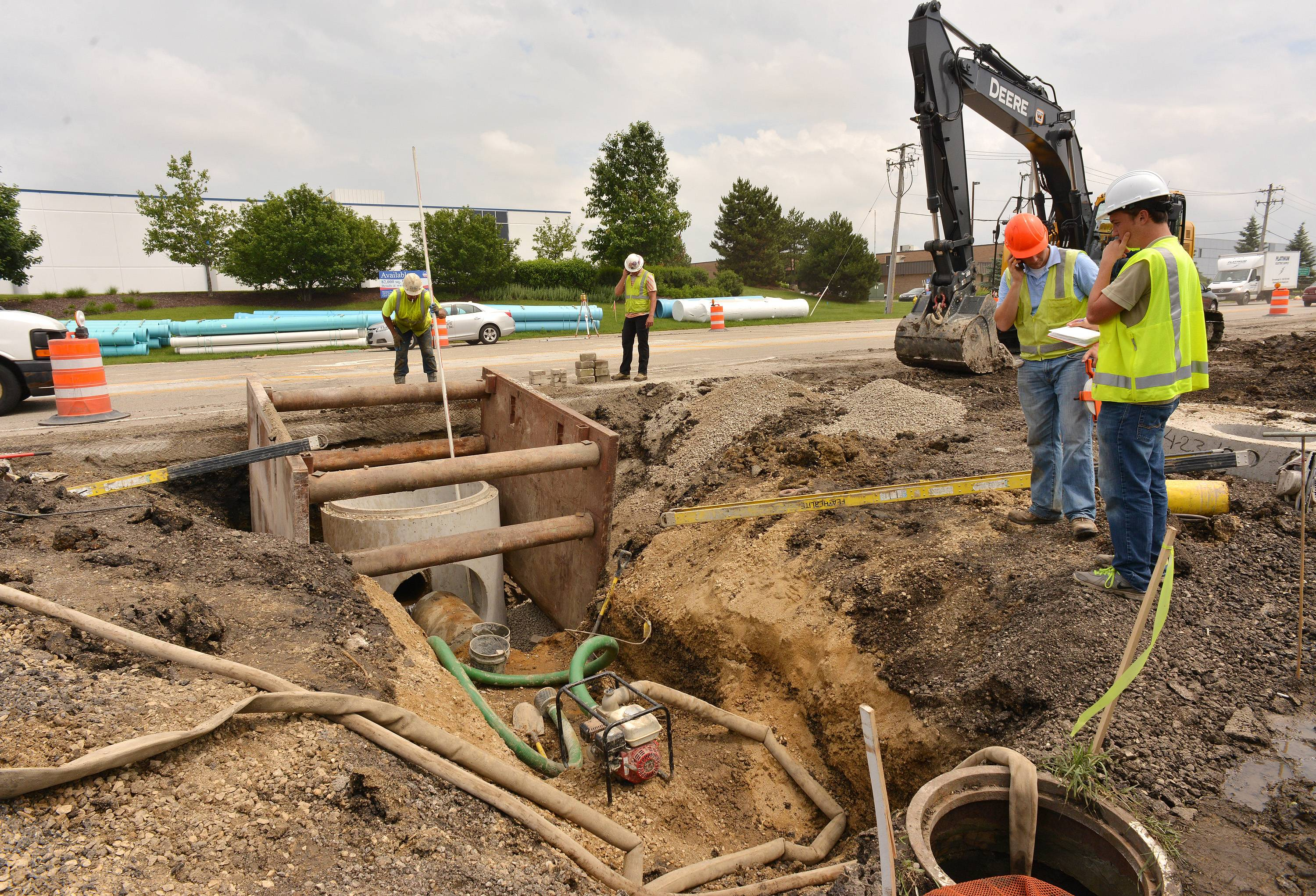 Crews are working to repair waterlogged pipes before continuing with work along Gary Avenue in Carol Stream.