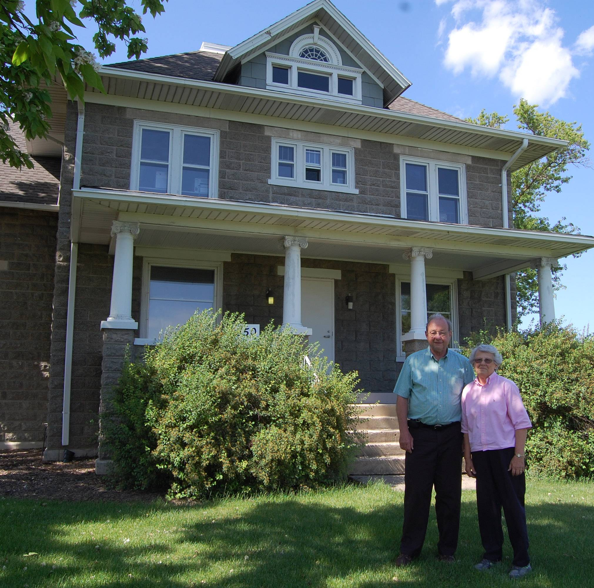 Warren Sunderlage, who celebrated his 50th wedding anniversary with a family reunion last weekend in Hoffman Estates, meets with his cousin, and family historian, Betty Sunderlage Getzelman of Bountiful, Utah. They are standing in front of the family home in Hoffman Estates