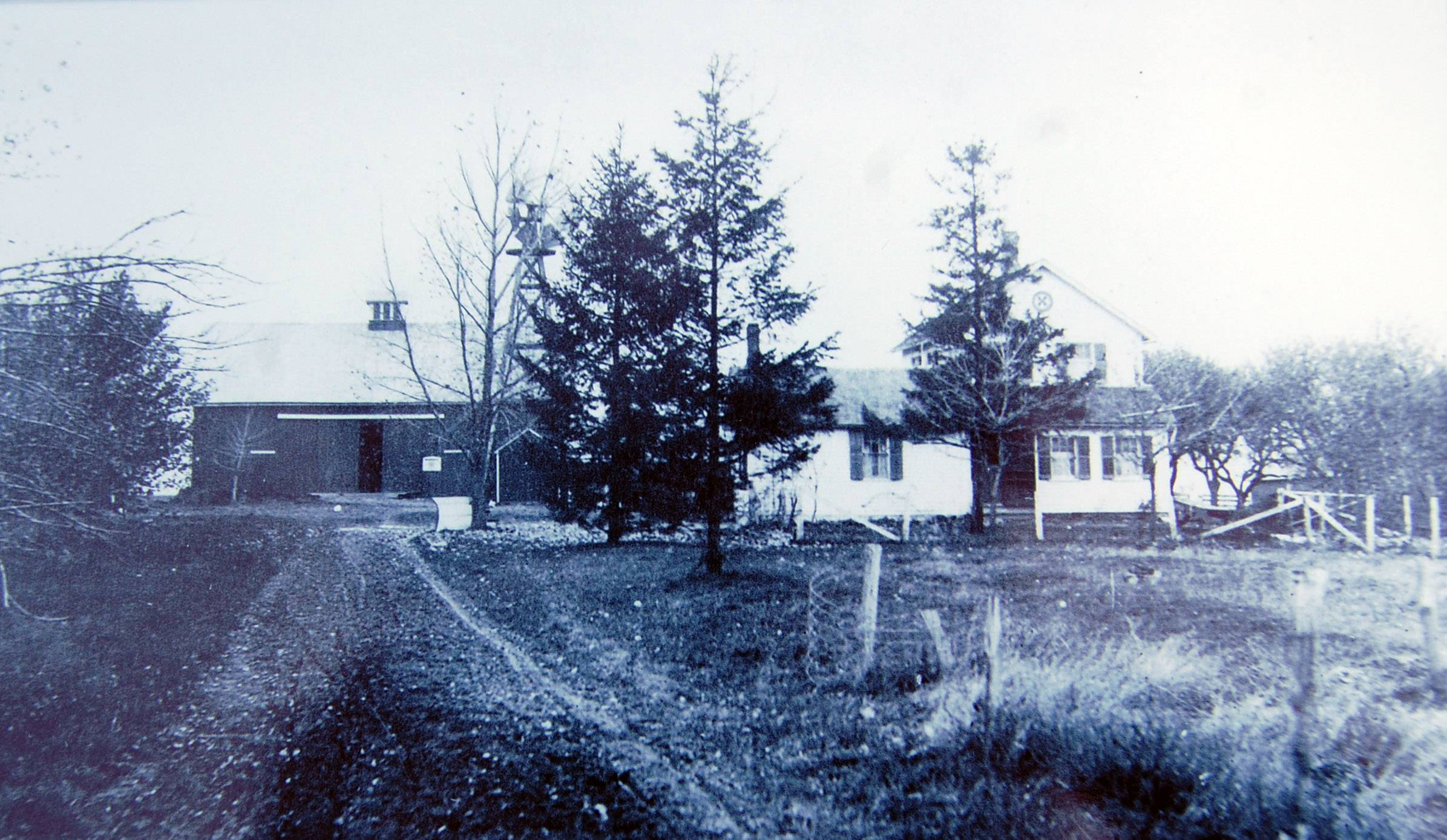 Original Sunderlage barn and wood house before a 1937 barn fire destroyed it.