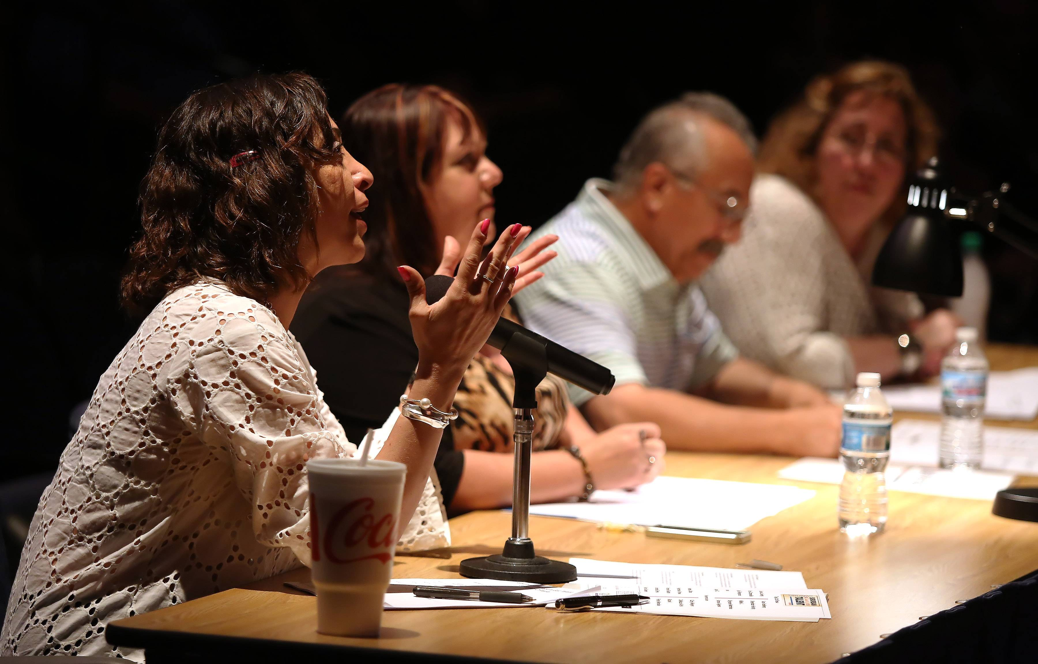 Judge Diana Martinez gives her view on an act during Sunday's performance of the top 20 finalists of the Suburban Chicago's Got Talent competition Sunday at the Prairie Center for the Arts in Schaumburg.